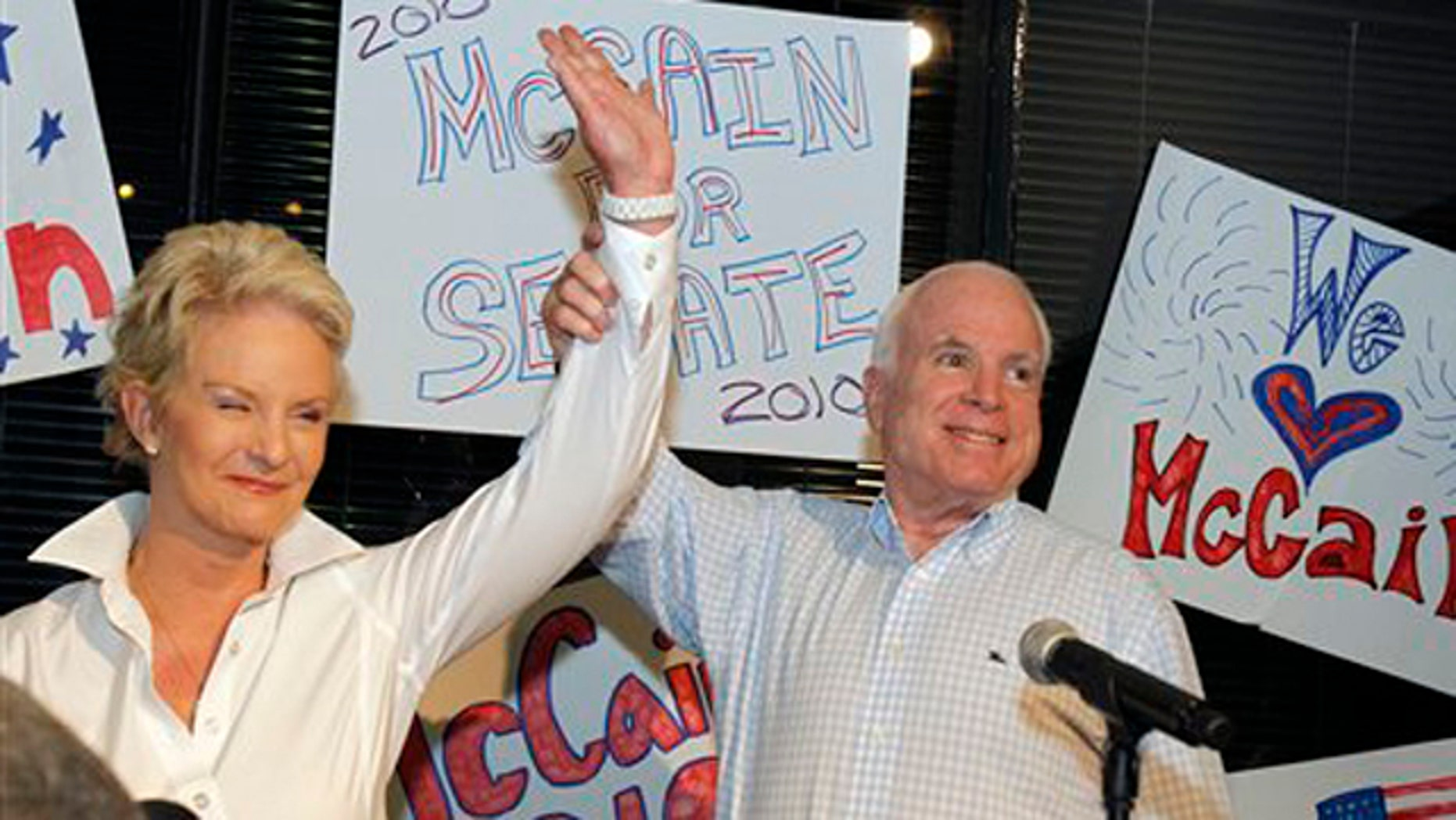 Aug. 23: Sen. John McCain with his wife Cindy McCain gets applause from supporters in Phoenix. (AP Photo)