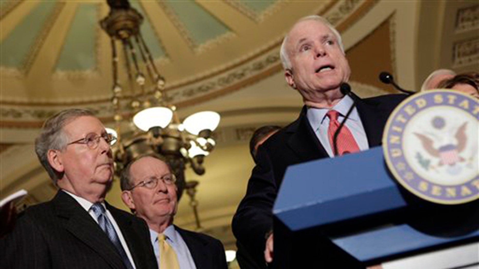 Sen. John McCain, right, speaks on Capitol Hill Dec. 1, accompanied by Senate Minority Leader Mitch McConnell, left, and Sen. Lamar Alexander. (AP Photo)