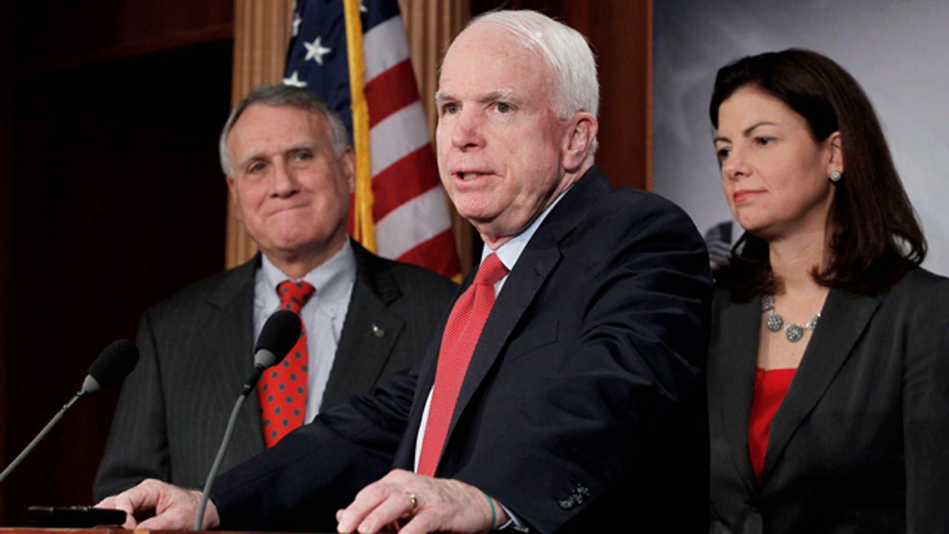 Dec. 14, 2011: Sen. John McCain, R-Ariz., ranking Republican on the Senate Armed Services Committee, center, flanked by Senate Minority Whip Jon Kyl of Ariz., and fellow committee member Sen. Kelly Ayotte, R-N.H., speaks during a news conference on Capitol Hill in Washington to announce an effort to replace the defense sequester mandated as a result of the Supercommittee's failure.