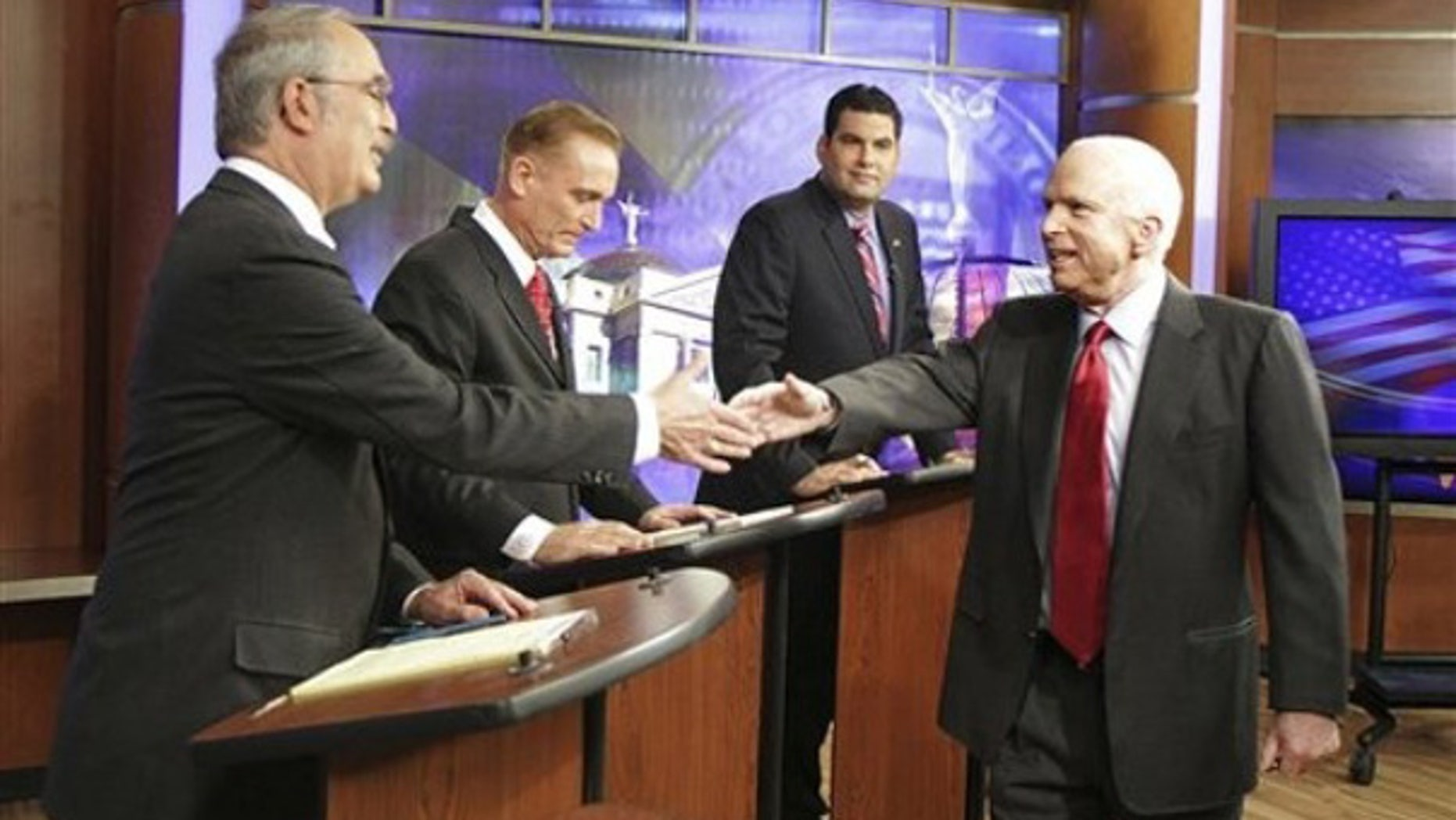 Sunday: U.S. Sen John McCain, R-Ariz., right, shakes hands with Libertarian U.S. Senate candidate David Nolan, left, after greeting Green Party candidate Jerry Joslyn and Democrat Rodney Glassman prior to a debate at KTVK television studios in Phoenix.