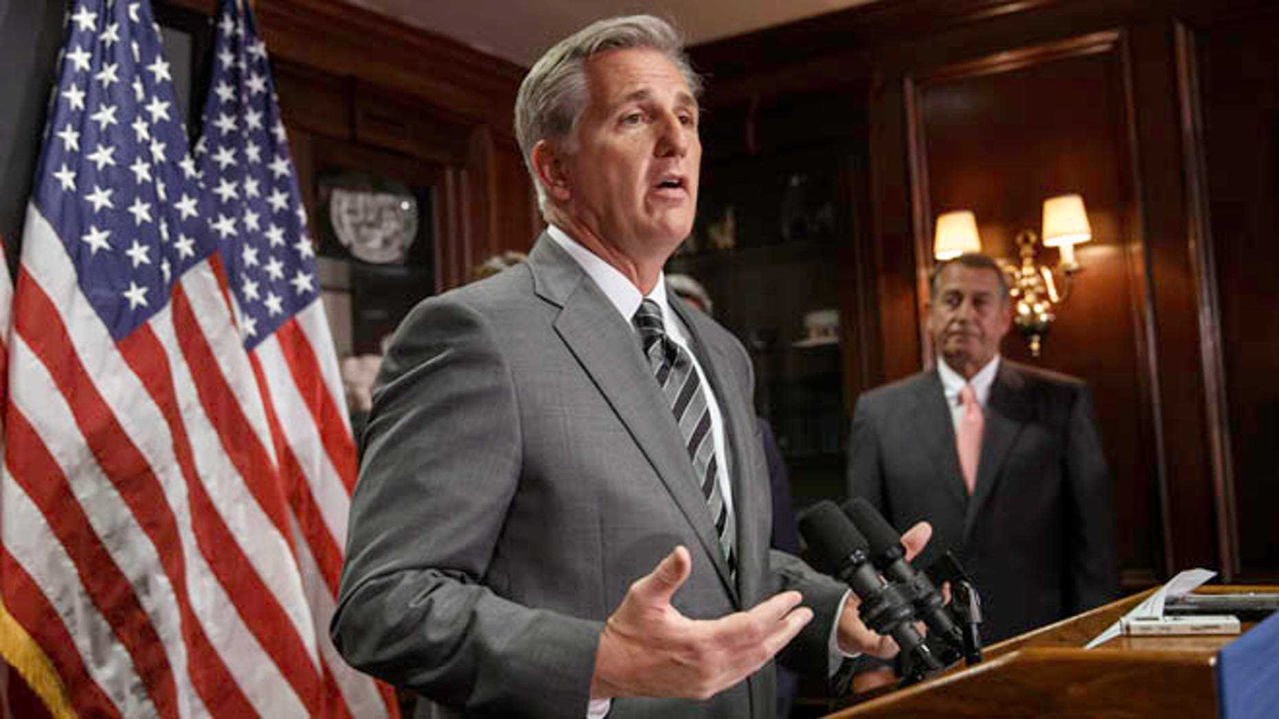 June 24, 2014: Incoming House Majority Leader Kevin McCarthy, joined at right by House Speaker John Boehner, meets with reporters on Capitol Hill.