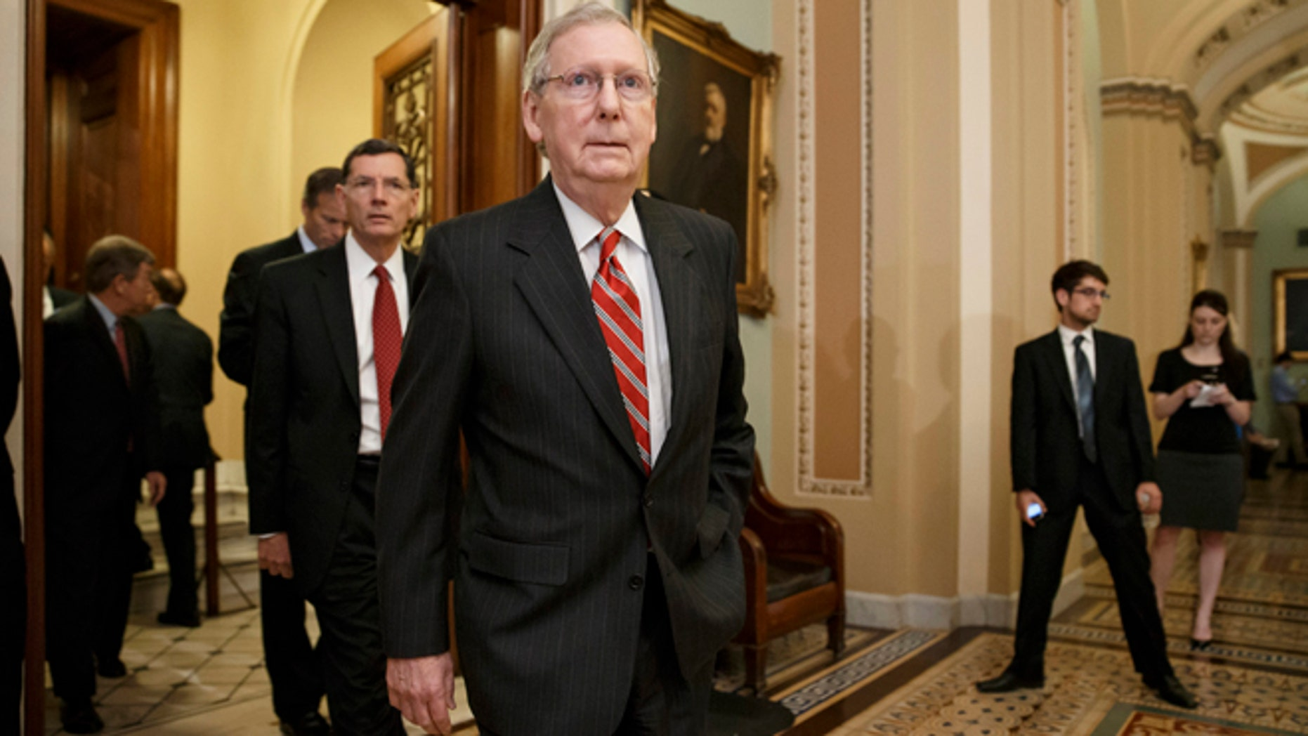 May 13, 2014: Senate Minority Leader Mitch McConnell of Ky. and other GOP lawmakers walk to meet reporters after a Republican caucus meeting on Capitol Hill in Washington.