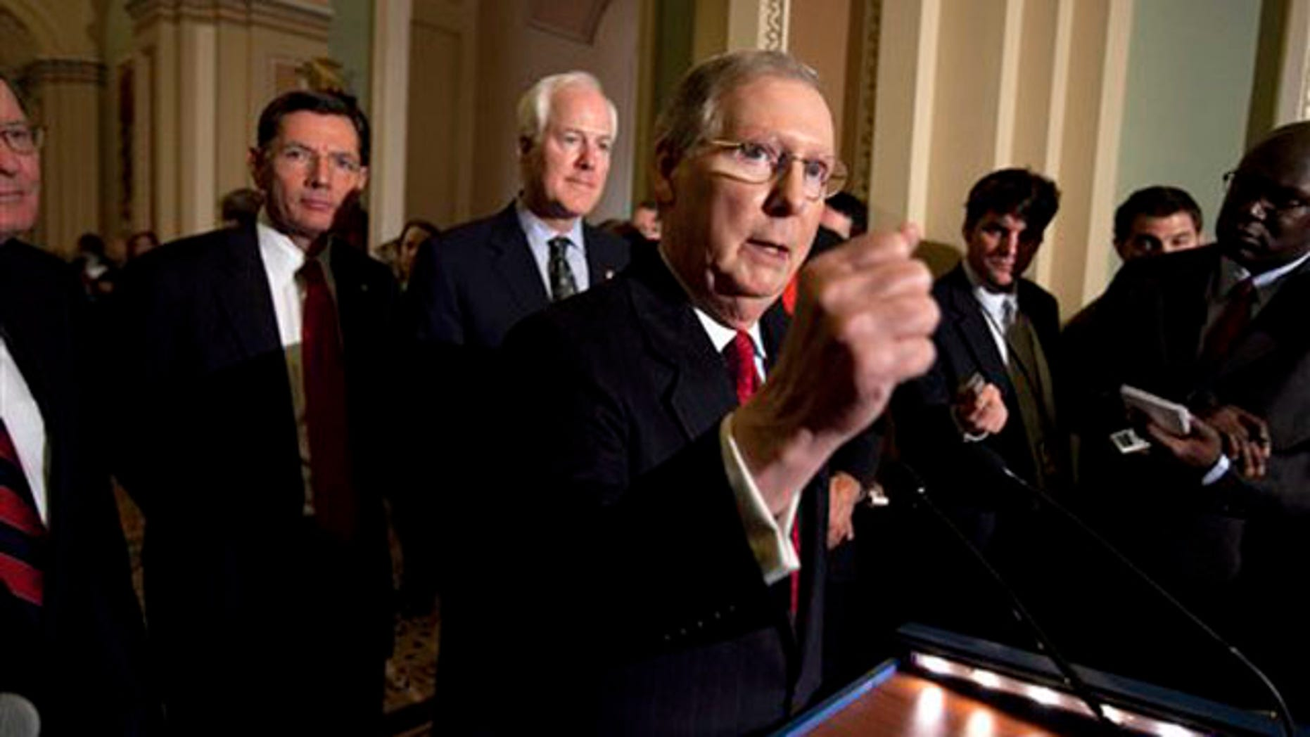 Senate Minority Leader Mitch McConnell speaks to reporters after the weekly caucus luncheons in Washington on Jan. 25.