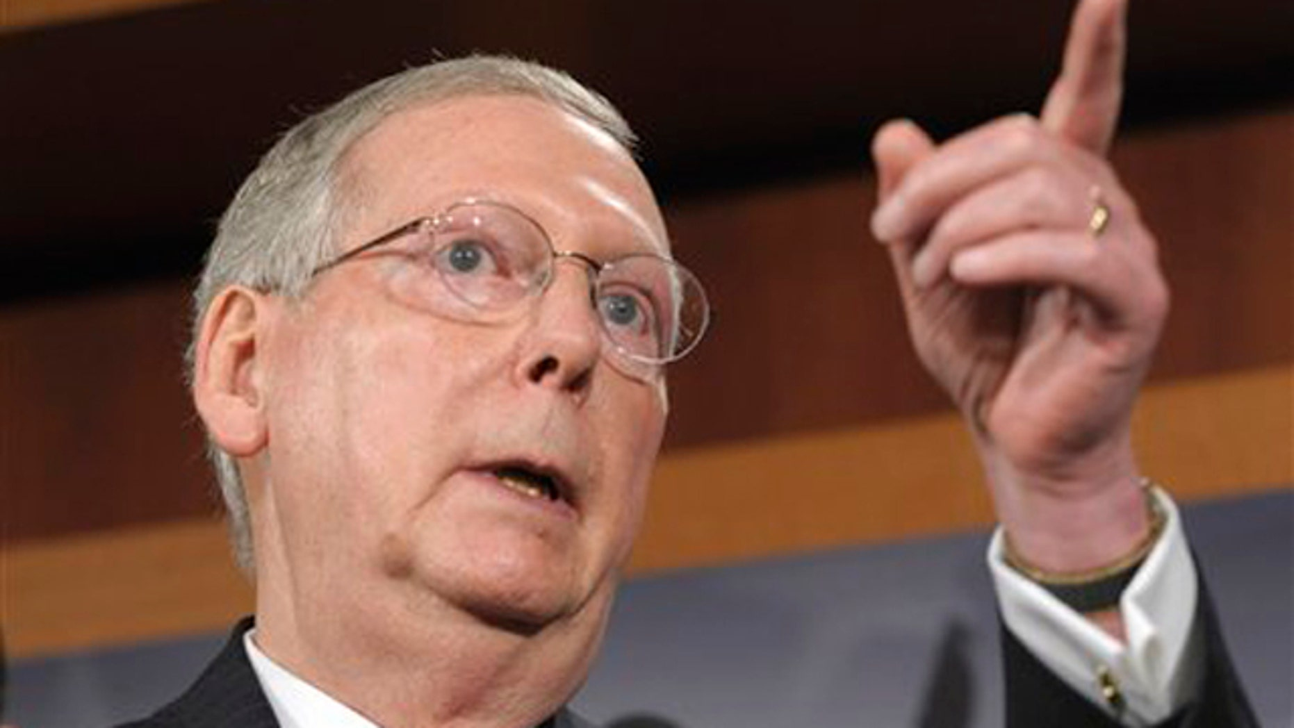 July 12: Senate Minority Leader Mitch McConnell gestures during a news conference on Capitol Hill.