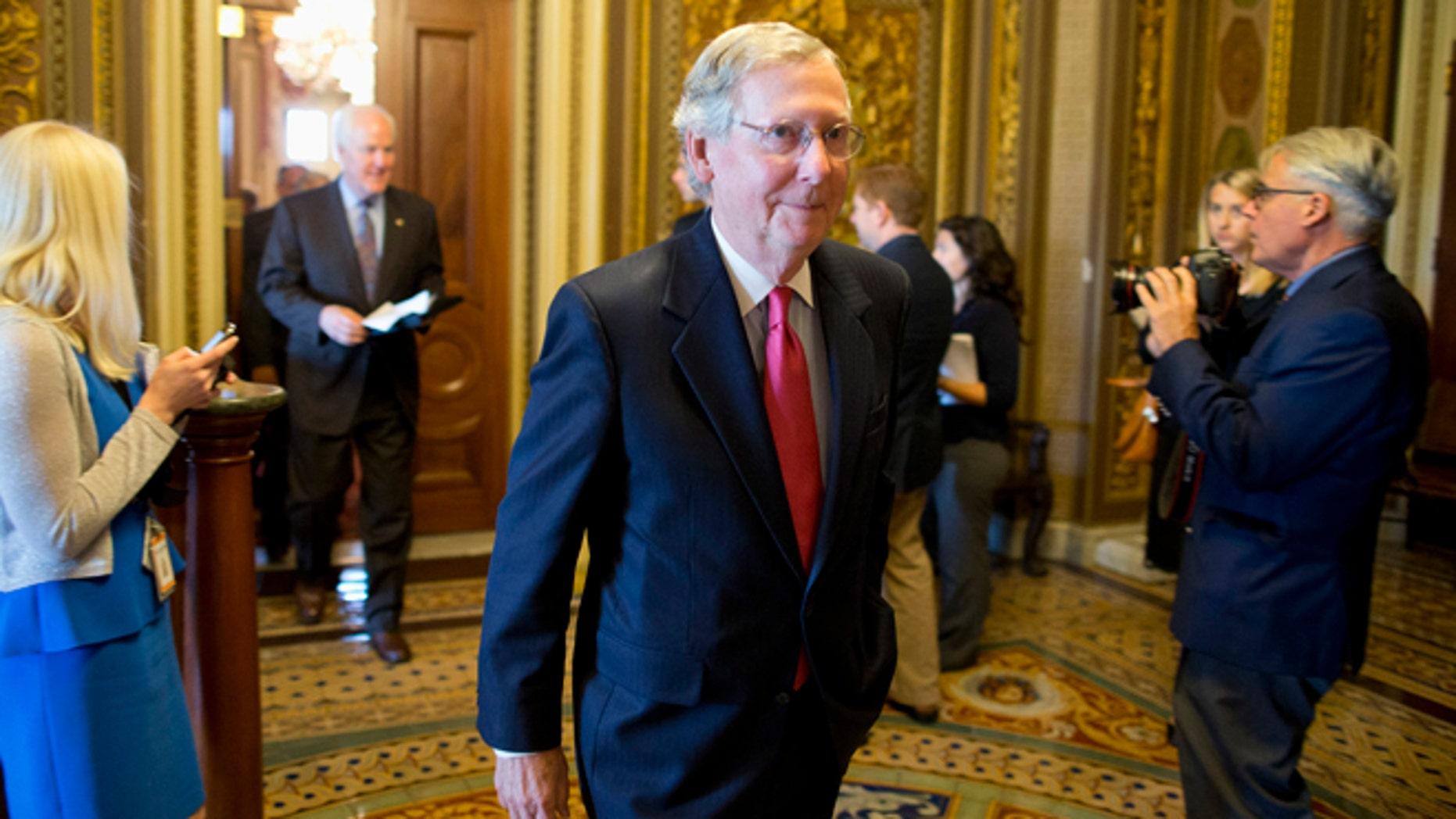 Oct. 8, 2013: Senate Minority Leader Mitch McConnell walks to the Senate floor on Capitol Hill in Washington.
