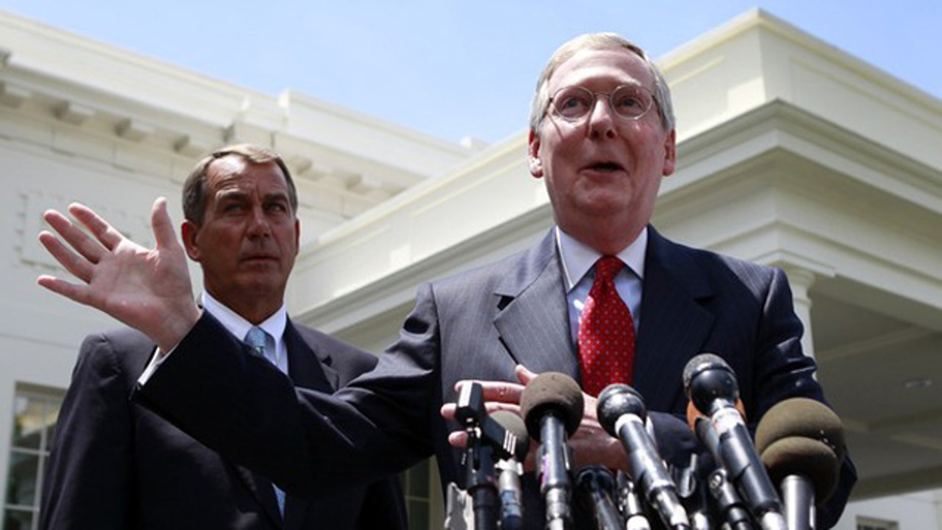 Senate Minority Leader Mitch McConnell, right, and House Minority Leader John Boehner are shown outside the White House June 10. (Reuters Photo)