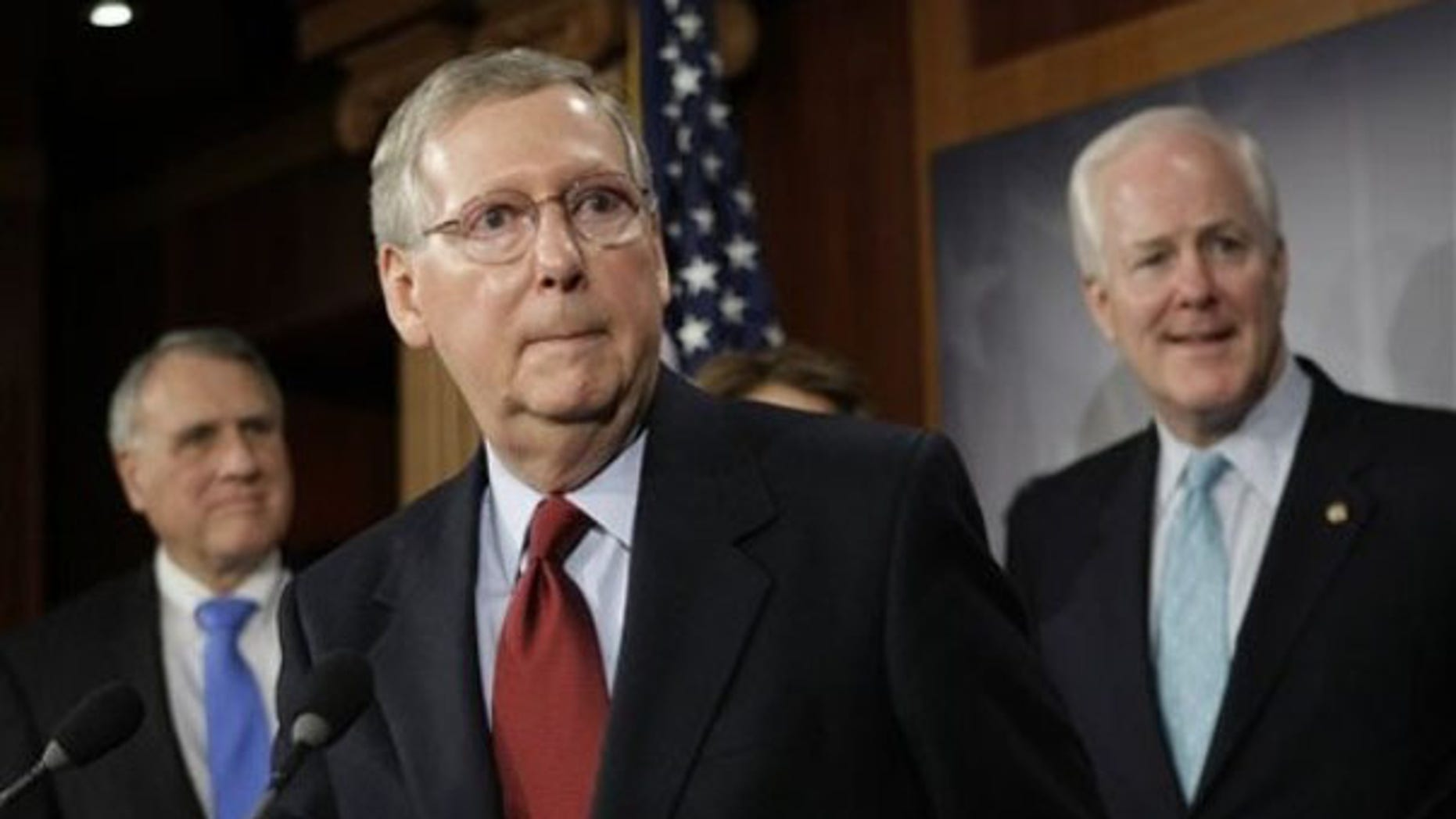 Sen. Mitch McConnell, center, speaks with reporters on Capitol Hill Jan. 27. (AP Photo)