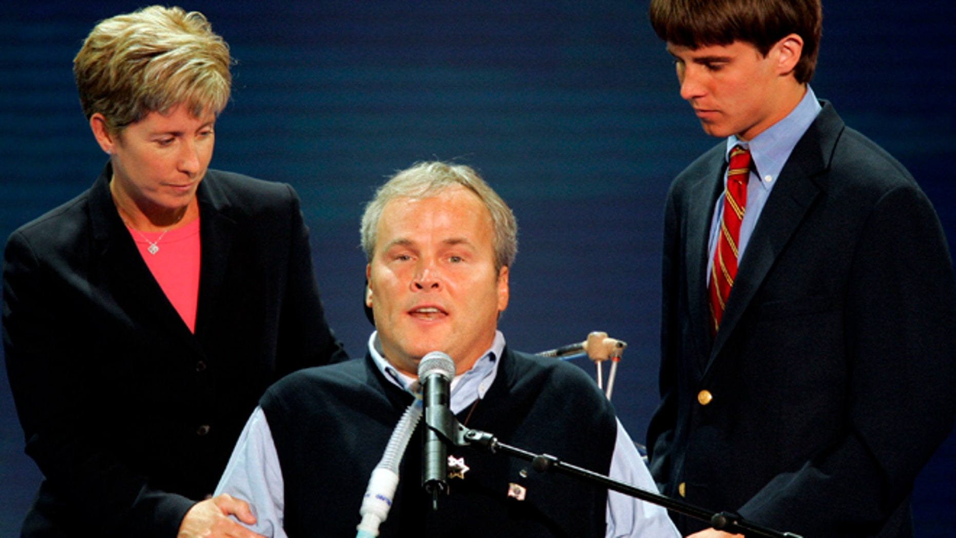 Disabled New York City police officer Steven McDonald is assisted by his wife Patti Ann and son Connor as he speaks during the second night of the 2004 Republican National Convention at Madison Square Garden in New York City, August 31, 2004.