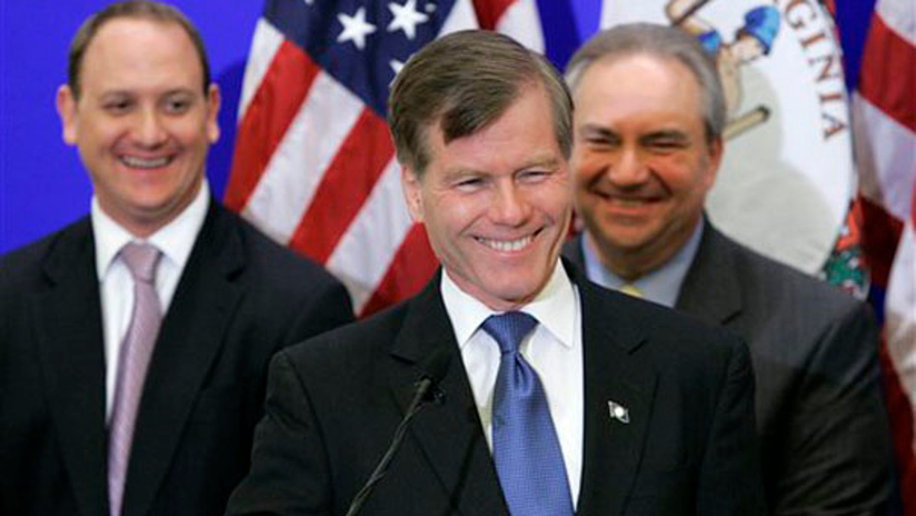 Republican Gov-elect Bob McDonnell smiles at a news conference with transition members, Phil Cox, left, and Lt. Gov. Bill Bolling, right, in Richmond Nov. 4.  (AP Photo)