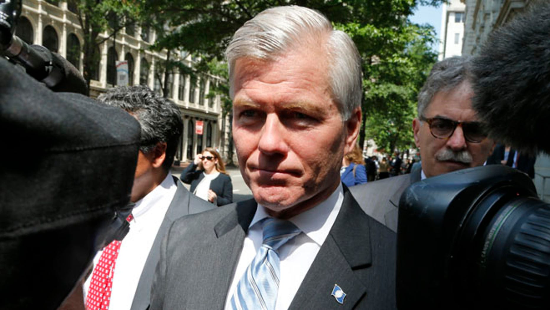 May 12, 2015: Former Virginia Gov. Bob McDonnell navigates a group of cameras as he leaves the 4th U.S. Circuit Court of Appeals after a hearing the appeal of his corruption conviction in Richmond, Va. (AP)