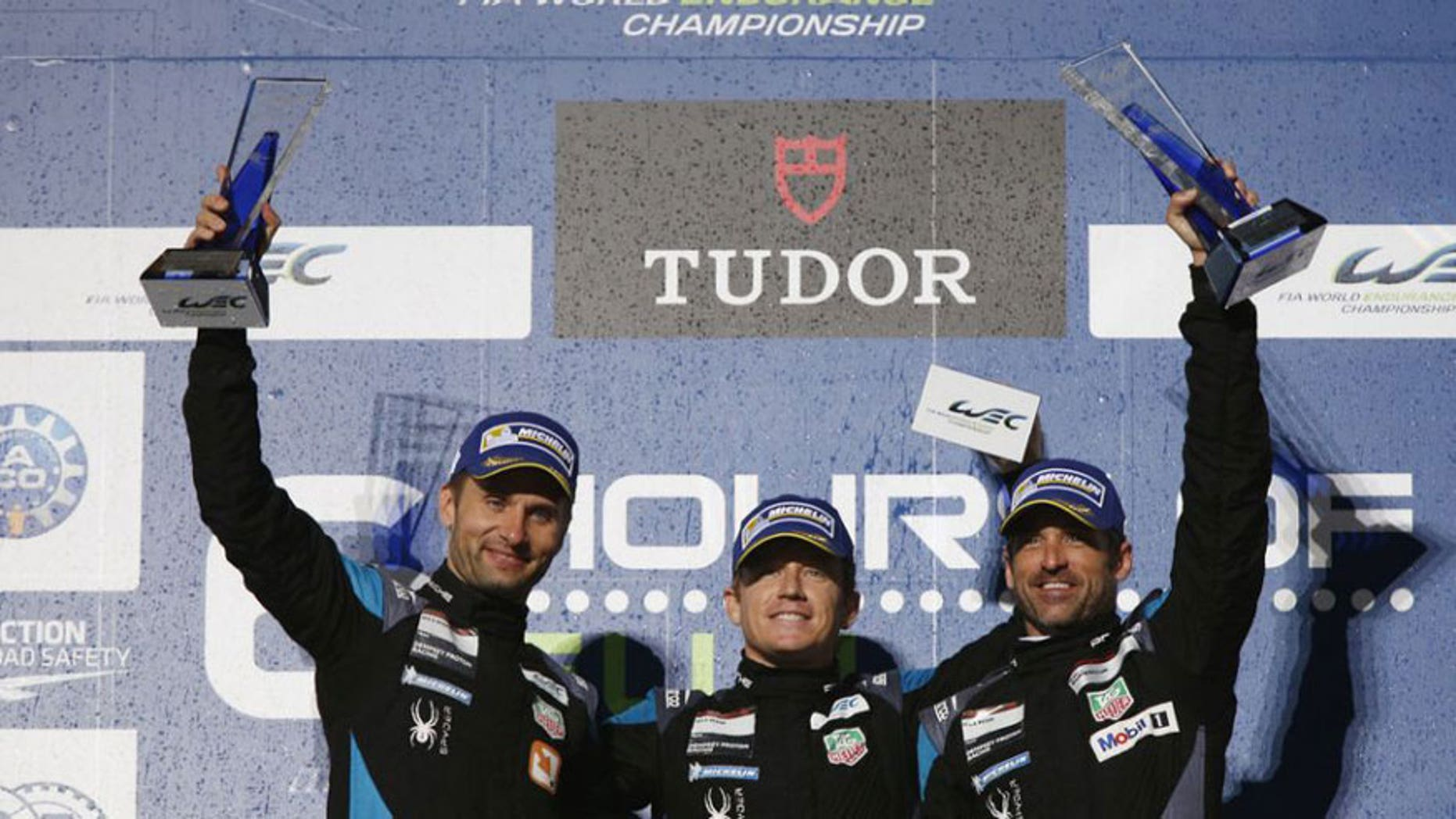 Dempsey Proton Racing drivers Marco Seefried, Patrick Long, and Patrick Dempsey.