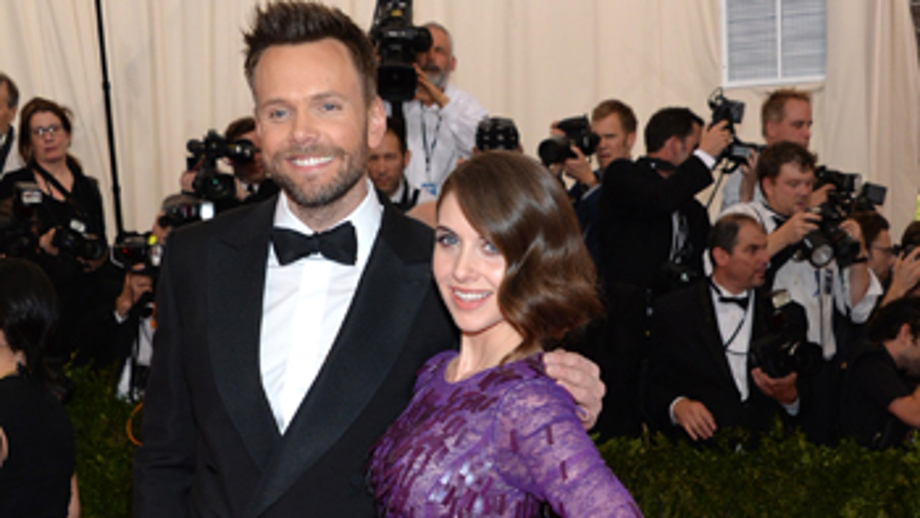 """Joel McHale, left, and Alison Brie arrive at The Metropolitan Museum of Art's Costume Institute benefit gala celebrating """"China: Through the Looking Glass"""" on Monday, May 4, 2015, in New York."""
