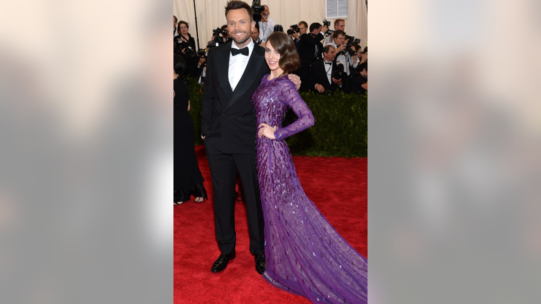 "Joel McHale, left, and Alison Brie arrive at The Metropolitan Museum of Art's Costume Institute benefit gala celebrating ""China: Through the Looking Glass"" on Monday, May 4, 2015, in New York."