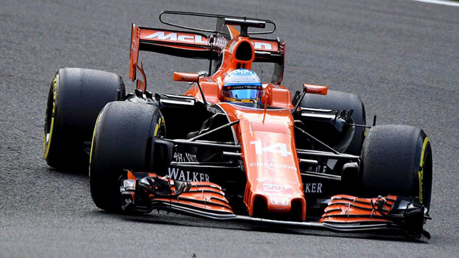 Mclaren driver Fernando Alonso of Spain steers his car during the Belgian Formula One Grand Prix in Spa-Francorchamps, Belgium, Sunday, Aug. 27, 2017. (AP Photo/Geert Vanden Wijngaert)