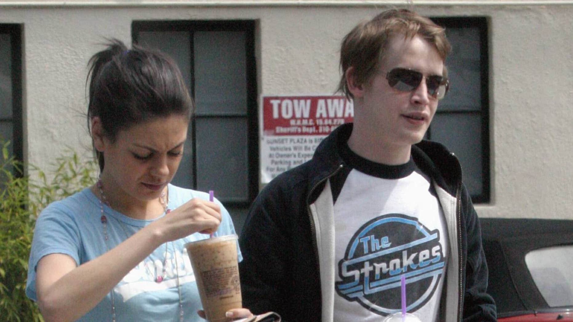 Mila Kunis (left) with then-boyfriend Macaulay Culkin after he testified at the Michael Jackson trial in 2005.