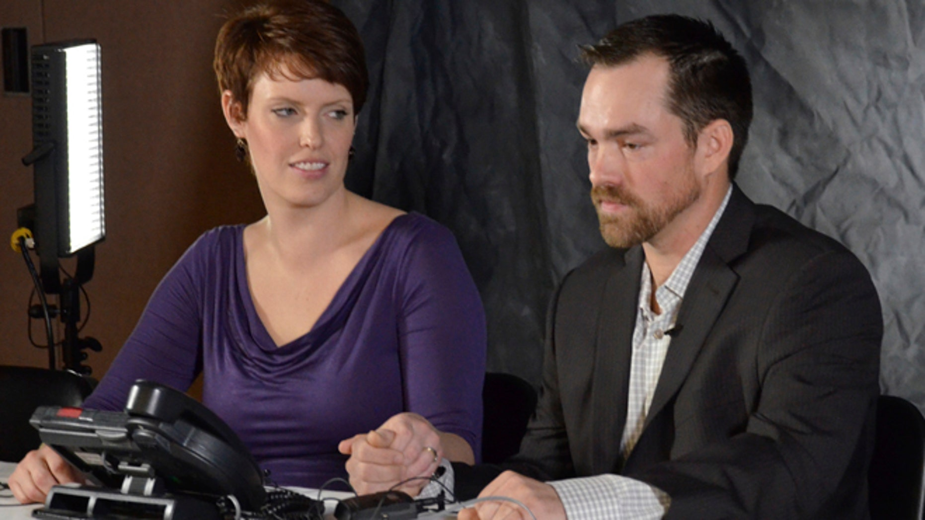 Jan. 16, 2013: In this file photo Clint Romesha, a North Dakota veteran set to receive the Medal of Honor for courageous action during a 13-hour firefight in Afghanistan, right, speaks at a news conference alongside his wife, Tammy, Wednesday in Minot, N.D.