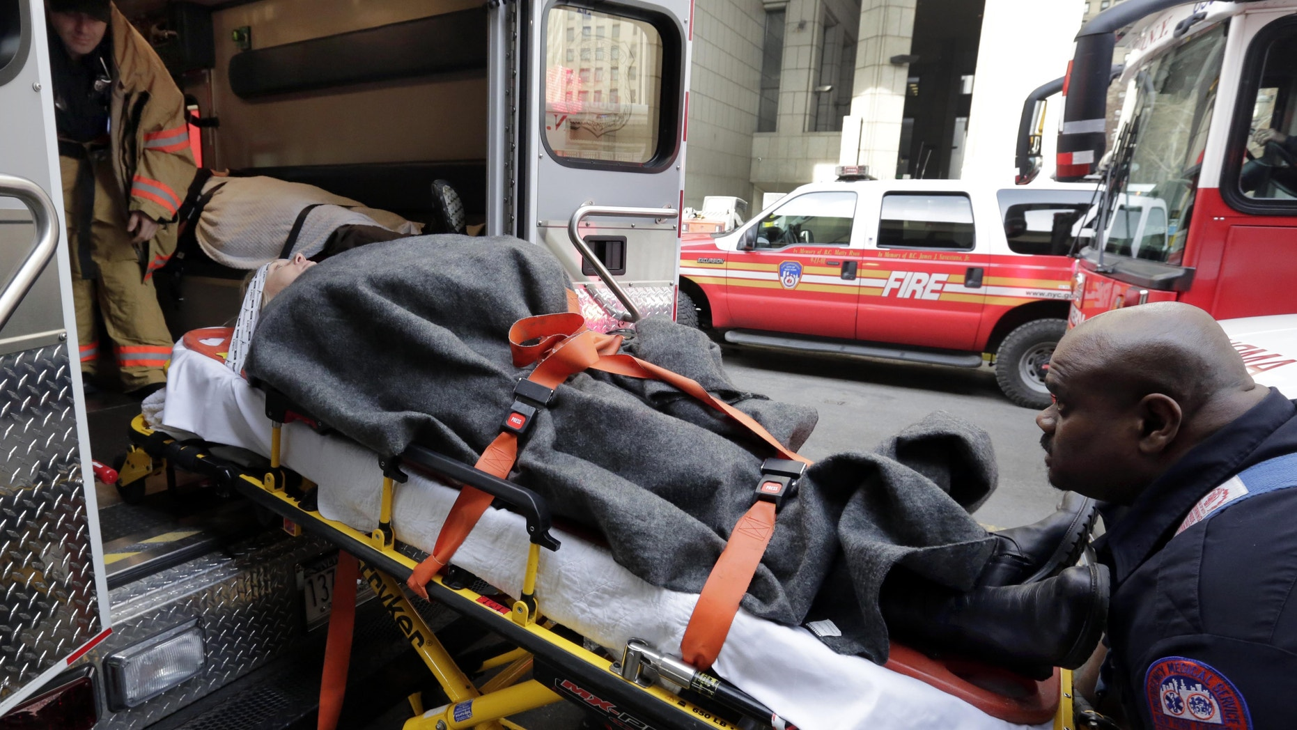 Jan. 9, 2013: An injured passenger of a New Jersey ferry is loaded into an ambulance, in New York.