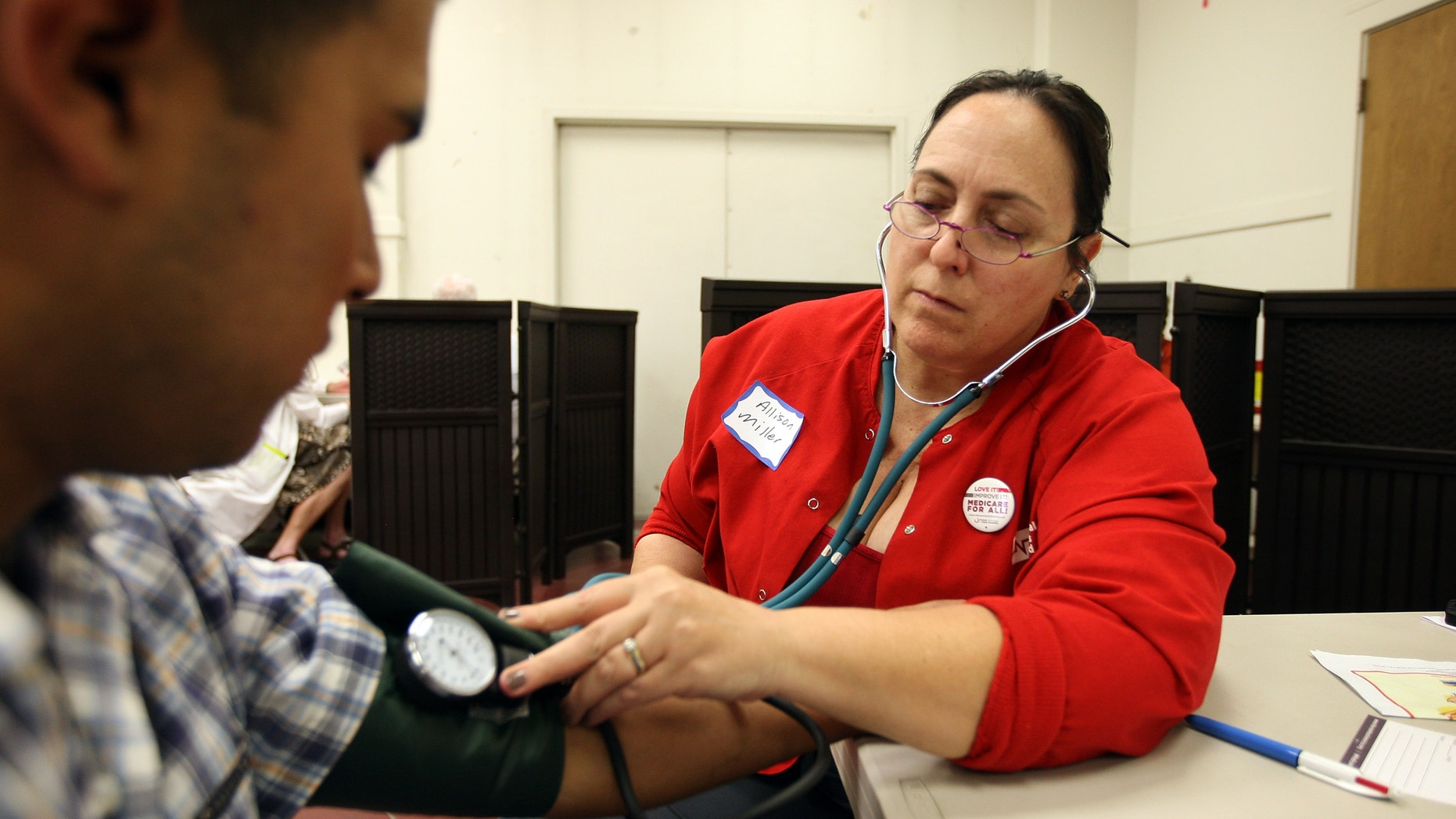 LOS ANGELES, CA - JULY 10:  Nurses and physicians give free basic health screenings and call attention to what they say is the ongoing healthcare emergency despite the decision of the U.S. Supreme Court to uphold the Affordable Care Act, on July 10, 2012 in Los Angeles, California. Three days of free screenings in the Los Angeles area are part of the Medicare for All tour which is making up to two dozen stops across California between June 19 and July 12. The California Nurses Association says that 30 percent of Los Angeles County adults are uninsured and 18 percent cannot afford doctor visits.   (Photo by David McNew/Getty Images)