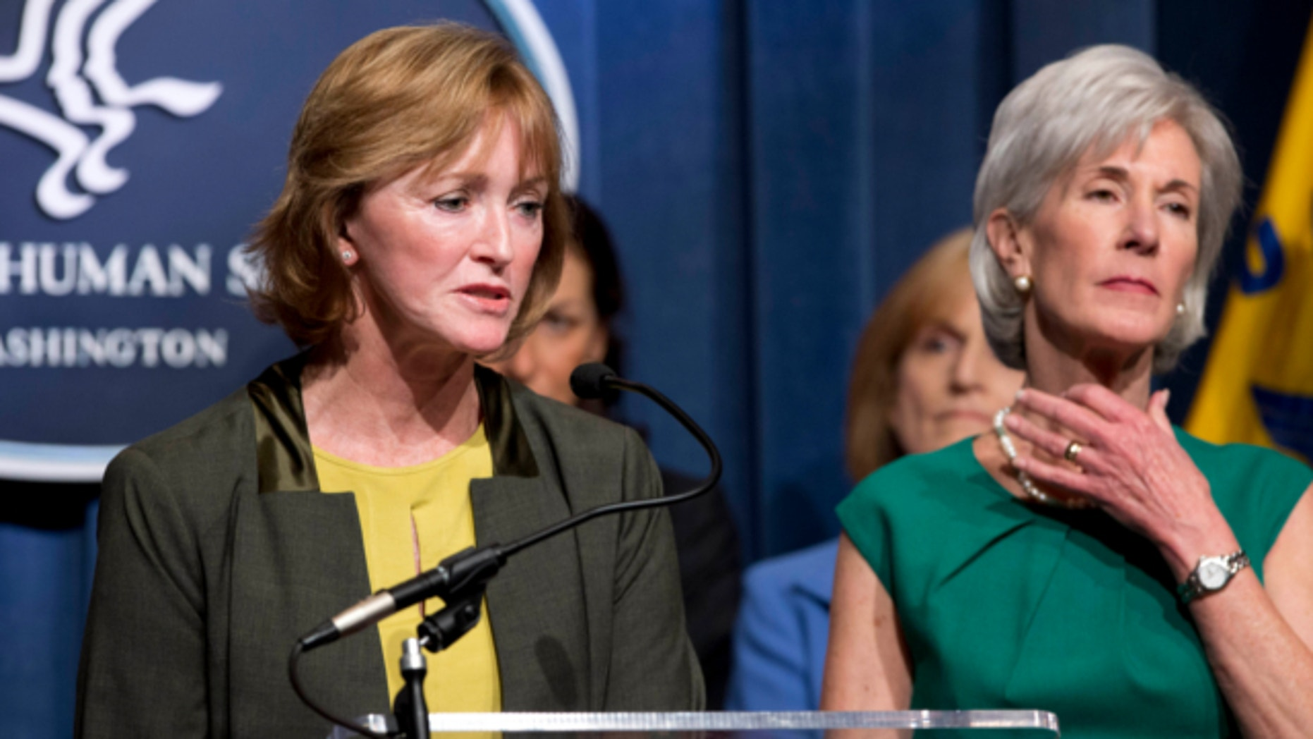 April 10, 2013: Centers for Medicare and Medicaid Services Acting Administrator Marilyn Tavenner, left, accompanied by Health and Human Services Secretary Kathleen Sebelius, speaks during a news conference at the Health and Humans Services (HHS) Department in Washington.