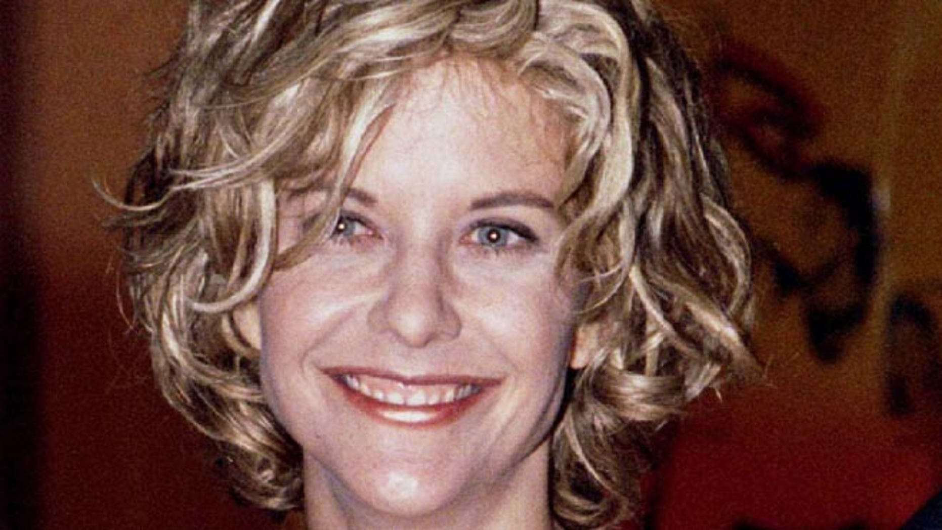 """Meg Ryan, one of the stars of the new film """"Courage Under Fire,"""" poses at the film's premiere July 8. The film also stars Denzel-Washington. - RTXGMT1"""
