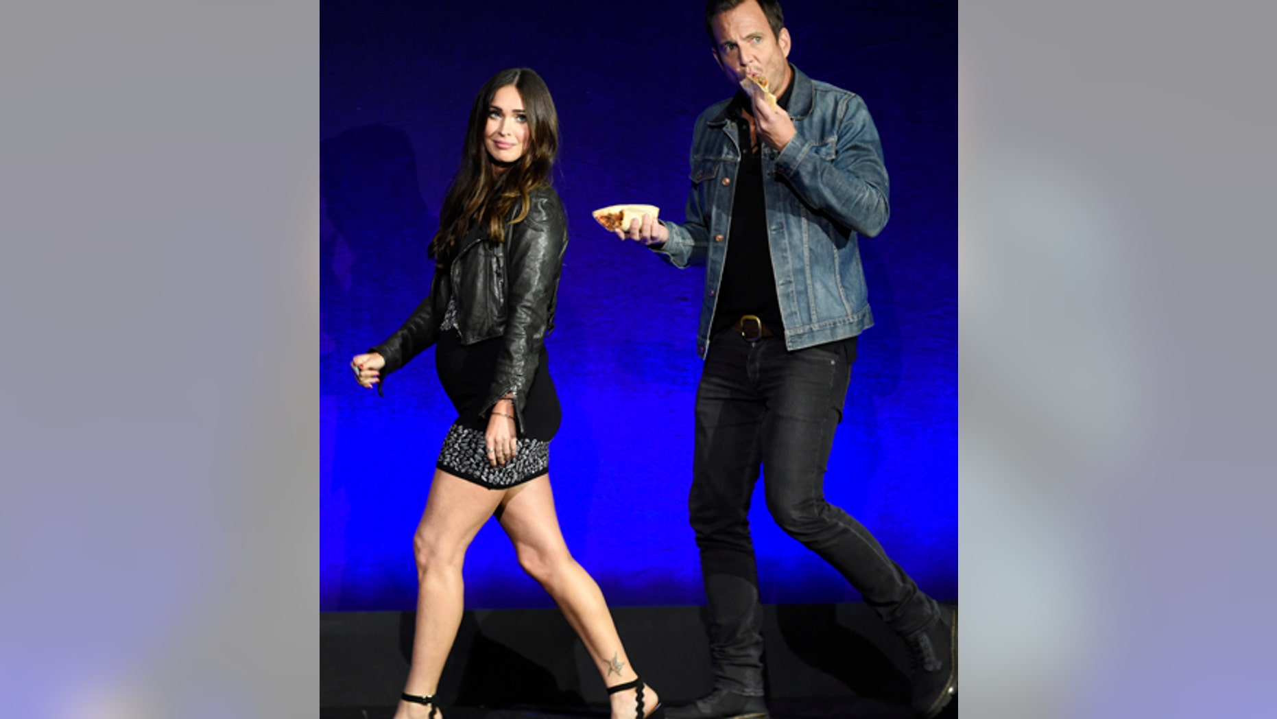 """Megan Fox, left, and Will Arnett, cast members in the upcoming film """"Teenage Mutant Ninja Turtles: Out of the Shadows,"""" take the stage during the Paramount Pictures presentation at CinemaCon 2016, the official convention of the National Association of Theatre Owners (NATO), at Caesars Palace on Monday, April 11, 2016, in Las Vegas, NV."""