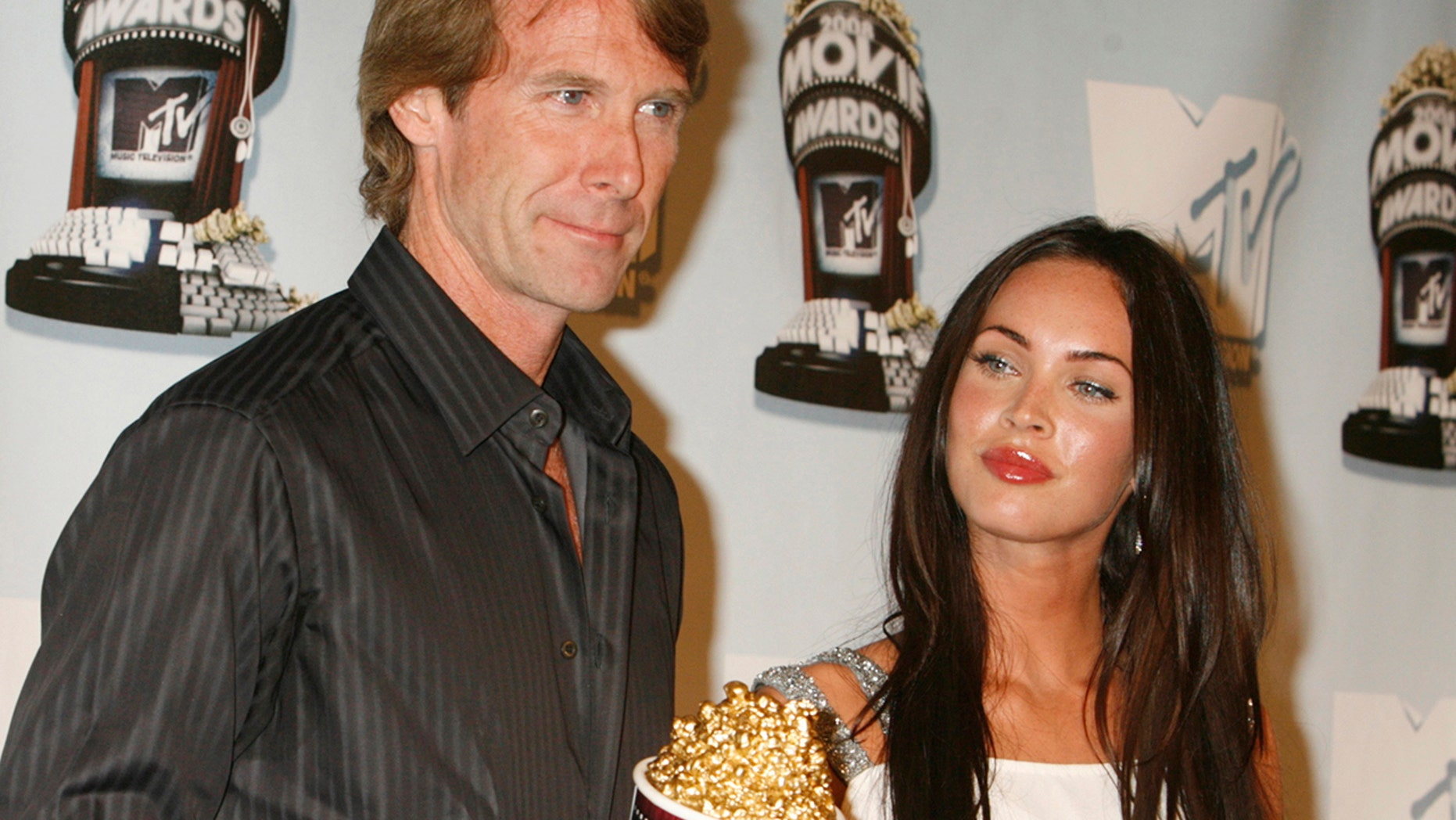 "Actress Megan Fox, star of the action film ""Transformers"", poses with the film's director Michael Bay who holds the Best Movie award won at the 2008 MTV Movie Awards in Los Angeles June 1, 2008."