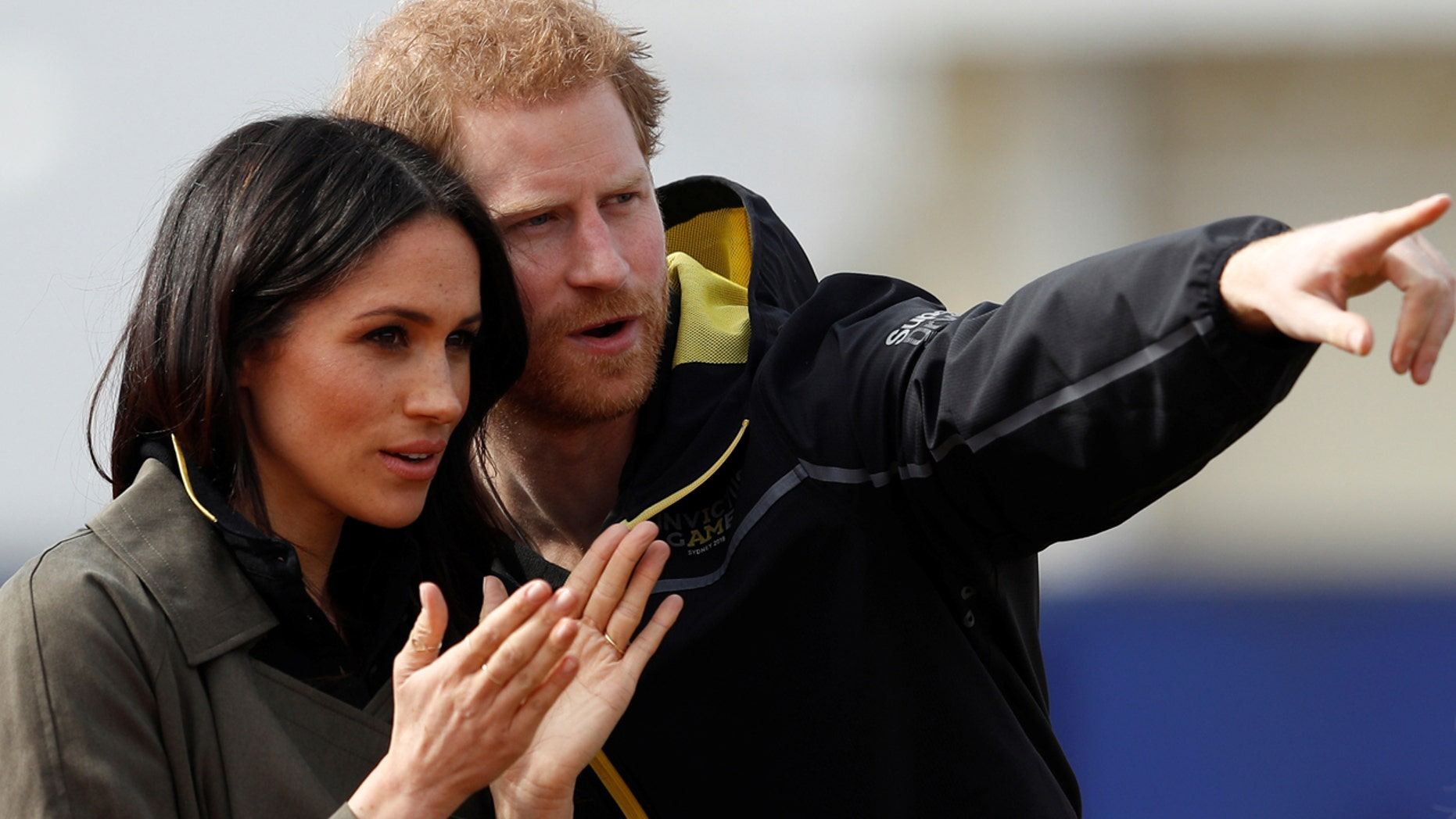 Britain's Prince Harry, Patron of the Invictus Games Foundation, and Meghan Markle watch athletes at the team trials for the Invictus Games Sydney 2018 at the University of Bath Sports Training Village in Bath, Britain, April 6, 2018.