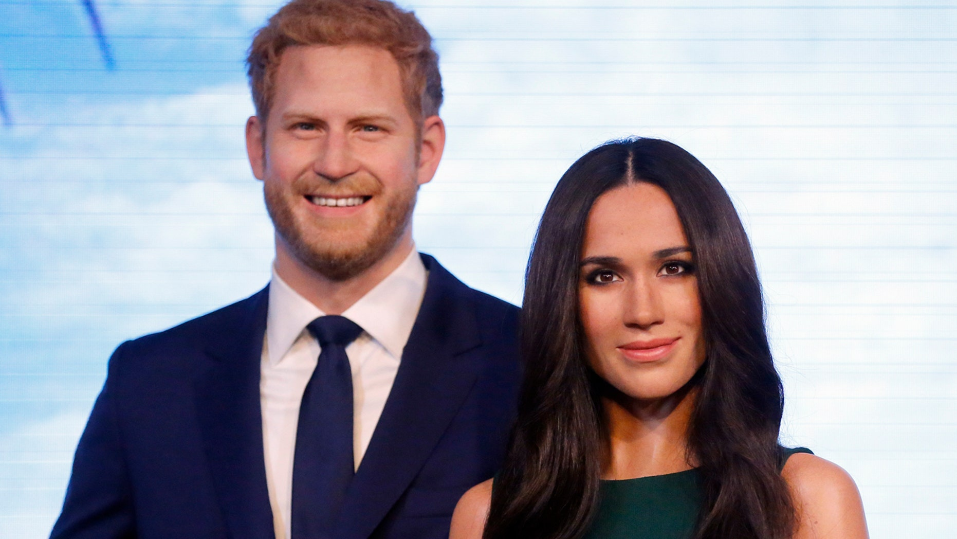 Britain's Prince Harry and his fiancee Meghan Markle are on display as wax figures at Madame Tussauds in London, Wednesday, May 9, 2018. As the world eyes are on the upcoming royal wedding, Madame Tussauds London unveils Meghan Markle's figure, standing alongside a re-styled figure of her groom, Prince Harry. (AP Photo/Frank Augstein)