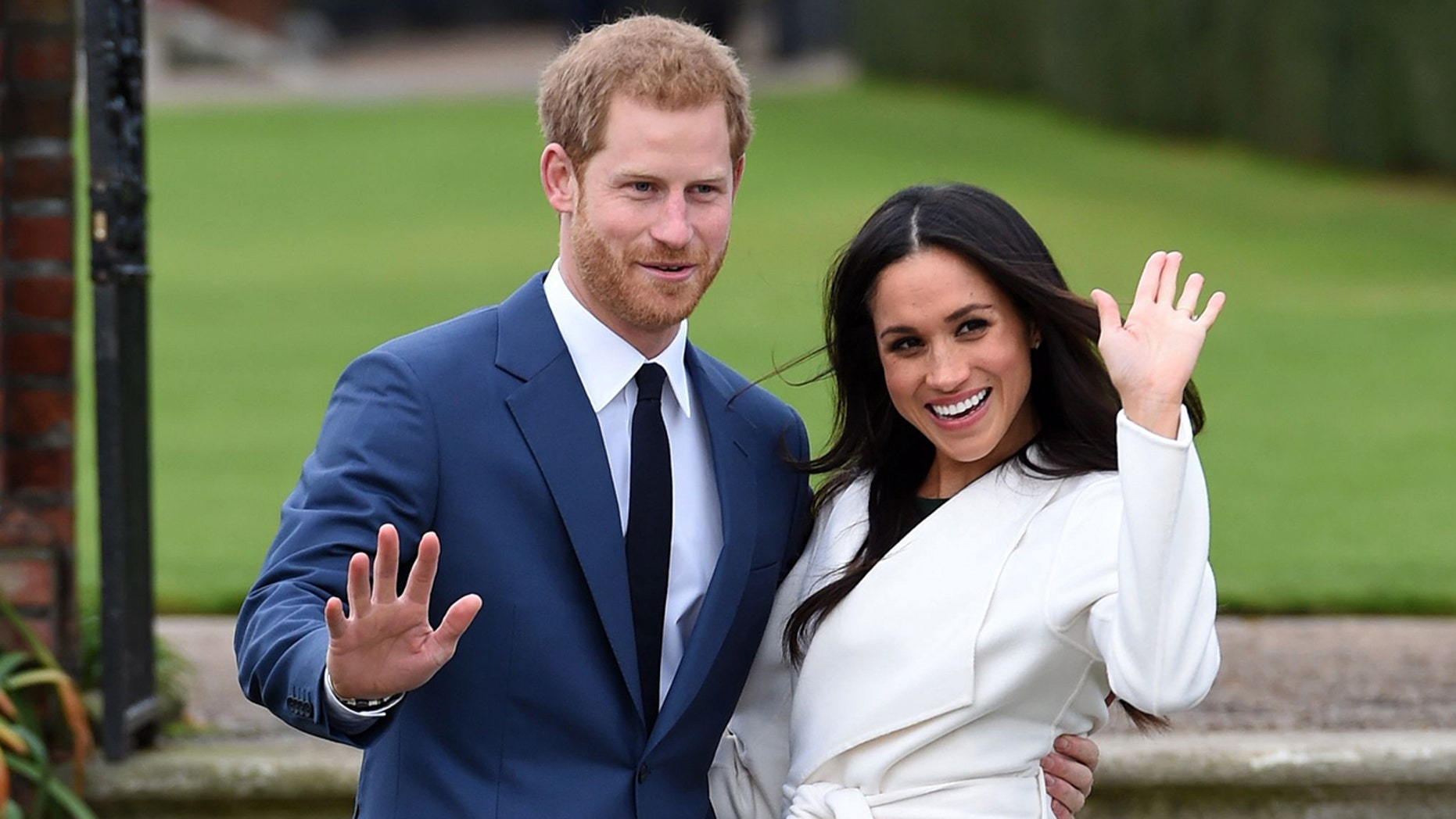 Prince Harry and his fiancee, American actress Meghan Markle, pose for photographers.