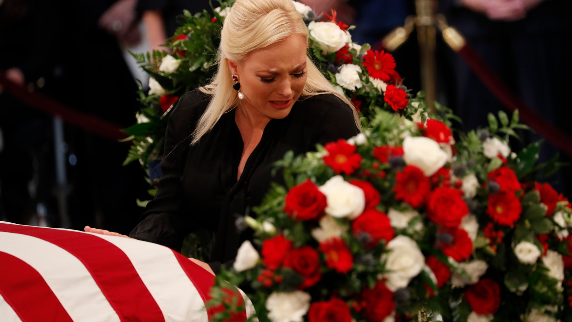WASHINGTON, DC - AUGUST 31: Meghan McCain, daughter of late U.S. Senator John McCain, touches her father's casket during ceremonies honoring the late US Senator John McCain inside the Rotunda of the U.S. Capitol, August 31, 2018 in Washington, DC. The late senator died August 25 at the age of 81 after a long battle with brain cancer. He will lie in state at the U.S. Capitol Friday, a rare honor bestowed on only 31 people in the past 166 years. Sen. McCain will be buried at his final resting place at the U.S. Naval Academy on Sunday. (Photo by Kevin Lamarque-Pool/Getty Images)