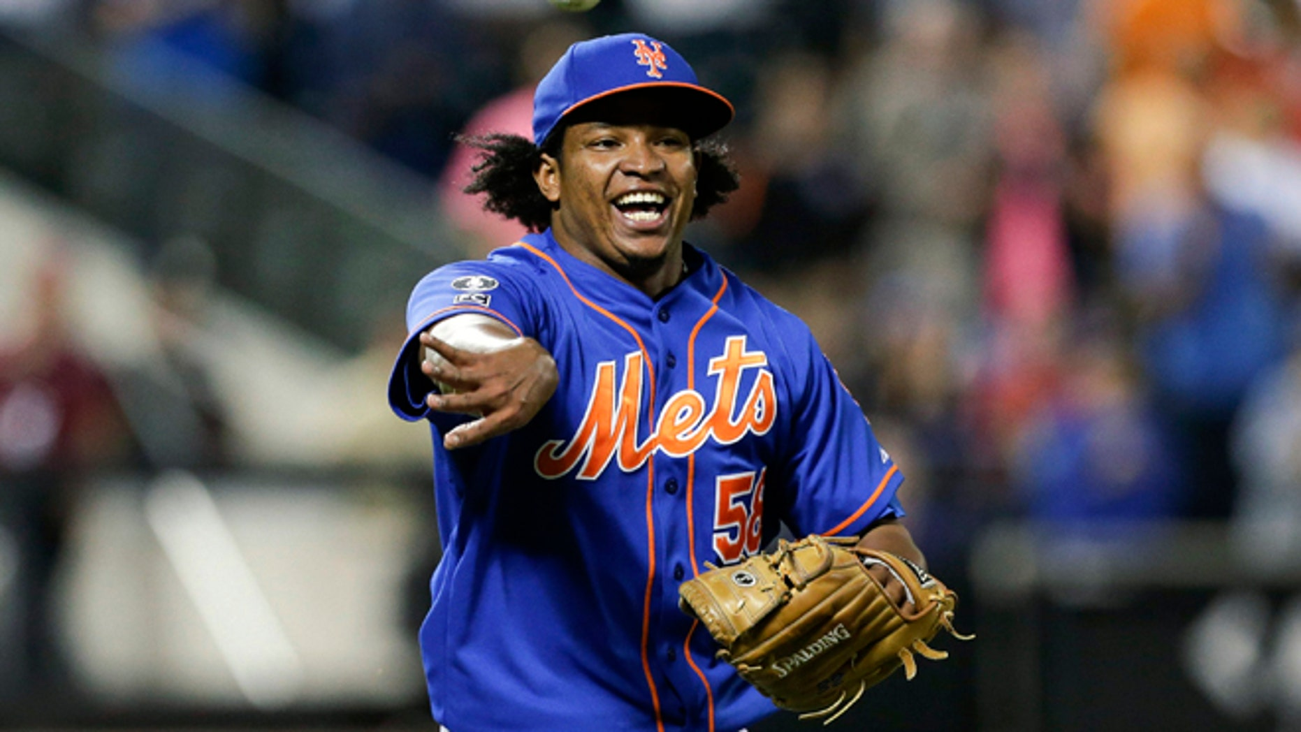 Sept. 10, 2014: New York Mets relief pitcher Jenrry Mejia tosses the ball to throw out Colorado Rockies' Josh Rutledge at first base to end a baseball game in New York. (AP)