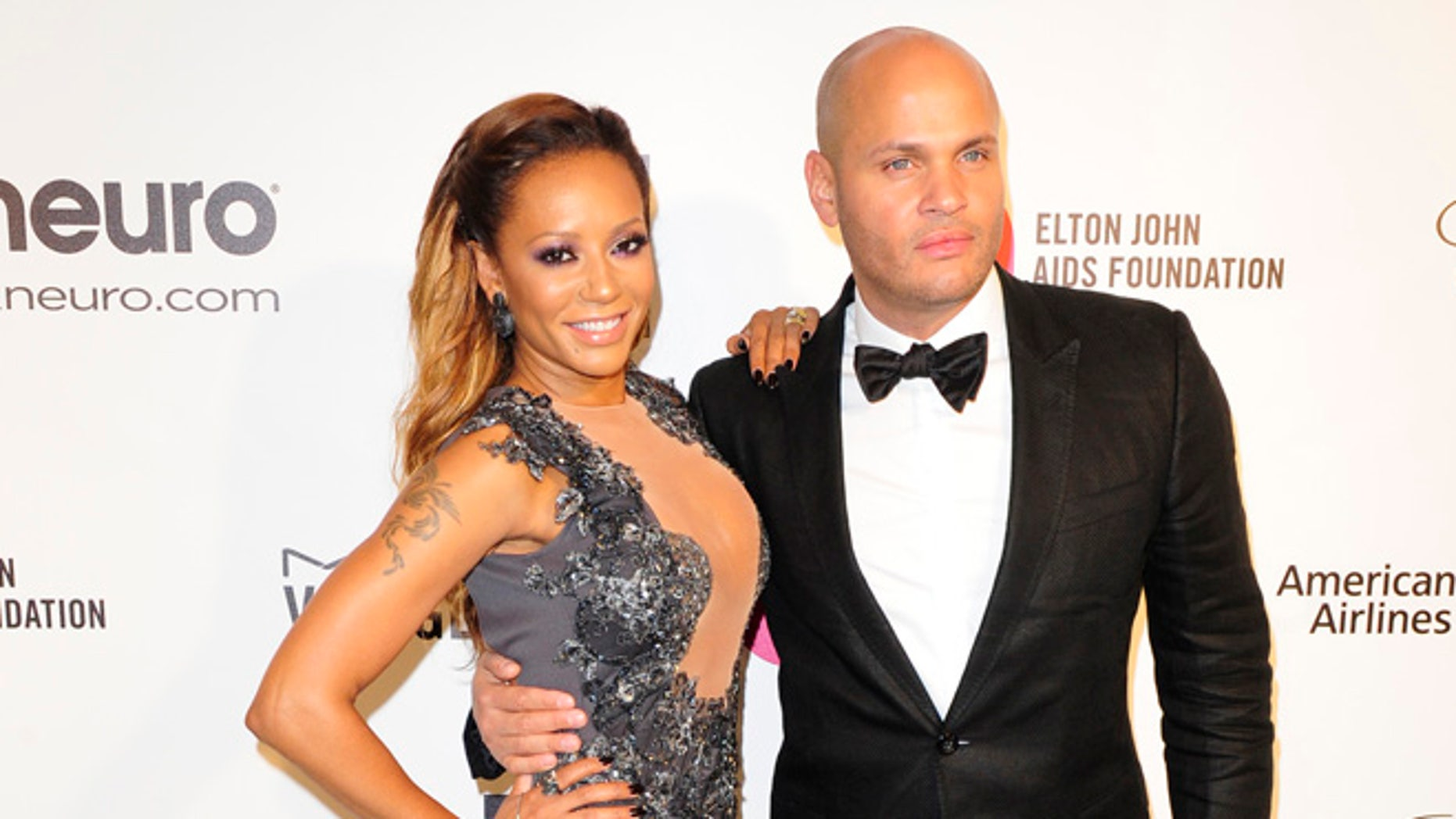 Pop singer and television personality Melanie Brown and spouse Stephen Belafonte arrive at the 2014 Elton John AIDS Foundation Oscar Party in West Hollywood, California March 2, 2014. REUTERS/Gus Ruelas (UNITED STATES TAGS: ENTERTAINMENT) (OSCARS-PARTIES) - RTR3FZ6Z