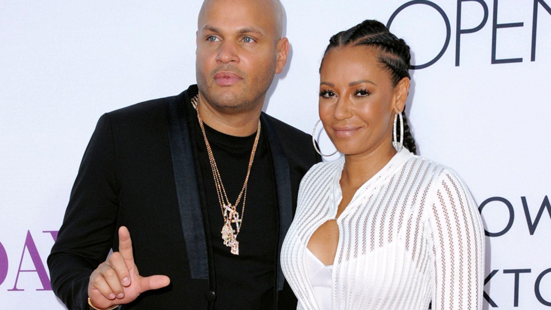 """In this April 13, 2016 file photo, Stephen Belafonte, left, and his wife Melanie Brown arrive at the Los Angeles premiere of """"Mother's Day."""" Court records in Los Angeles show the singer and """"America's Got Talent"""" judge filed for divorce from her husband of nearly 10 years, Stephen Belafonte,on Monday, March 20, 2017."""