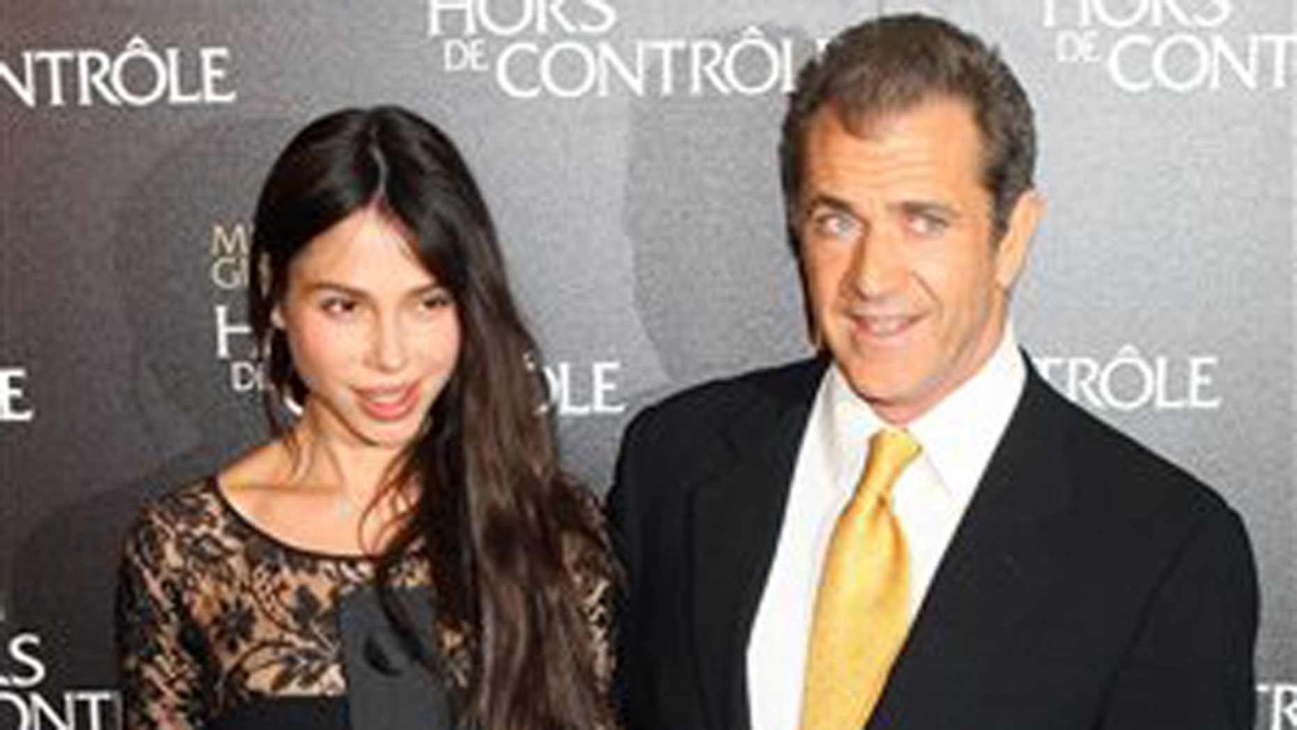 "Feb. 4, 2010: Mel Gibson and Oksana Grigorieva arrive at the ""Edge Of Darkness""  Premiere in Paris."