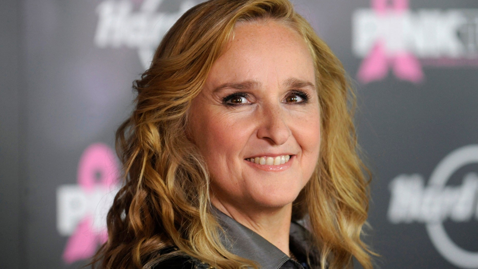Melissa Etheridge poses for photographers after receiving a star on the Hollywood Walk of Fame in Los Angeles September 27, 2011.