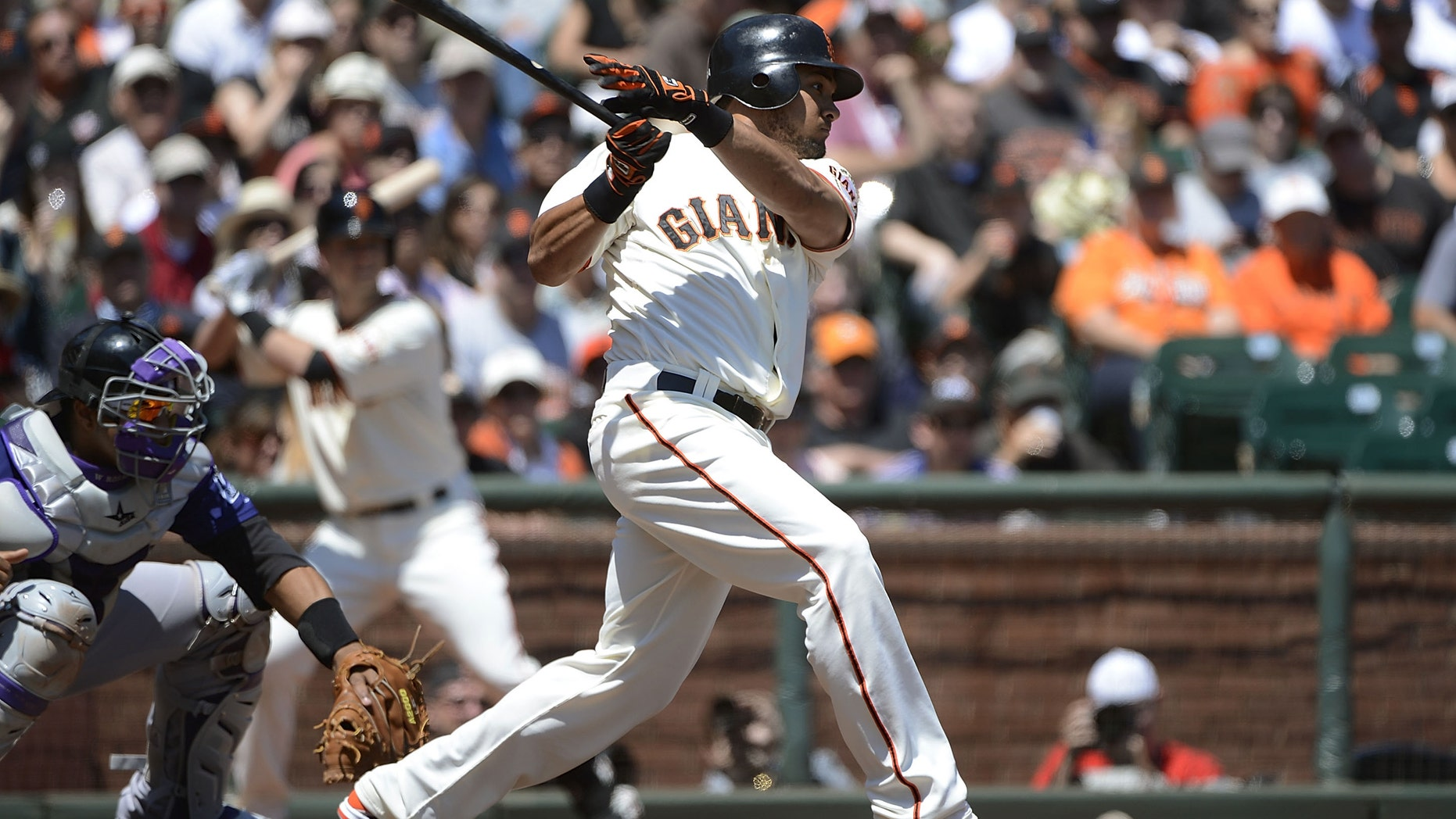 SAN FRANCISCO, CA - AUGUST 12:  Melky Cabrera #53 of the San Francisco Giants hits a two-run single driving in Angel Pagan #16 and Marco Scutaro #19 in the first inning against the Colorado Rockies at AT&T Park on August 12, 2012 in San Francisco, California.  (Photo by Thearon W. Henderson/Getty Images)