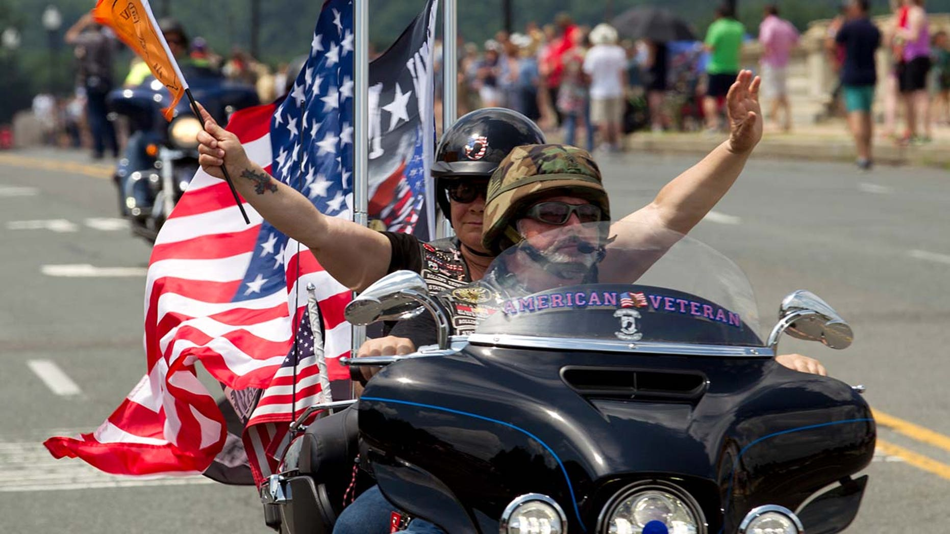 Participants in the Rolling Thunder motorcycle rally ride past Arlington Memorial Bridge ahead of Memorial Day in Washington.
