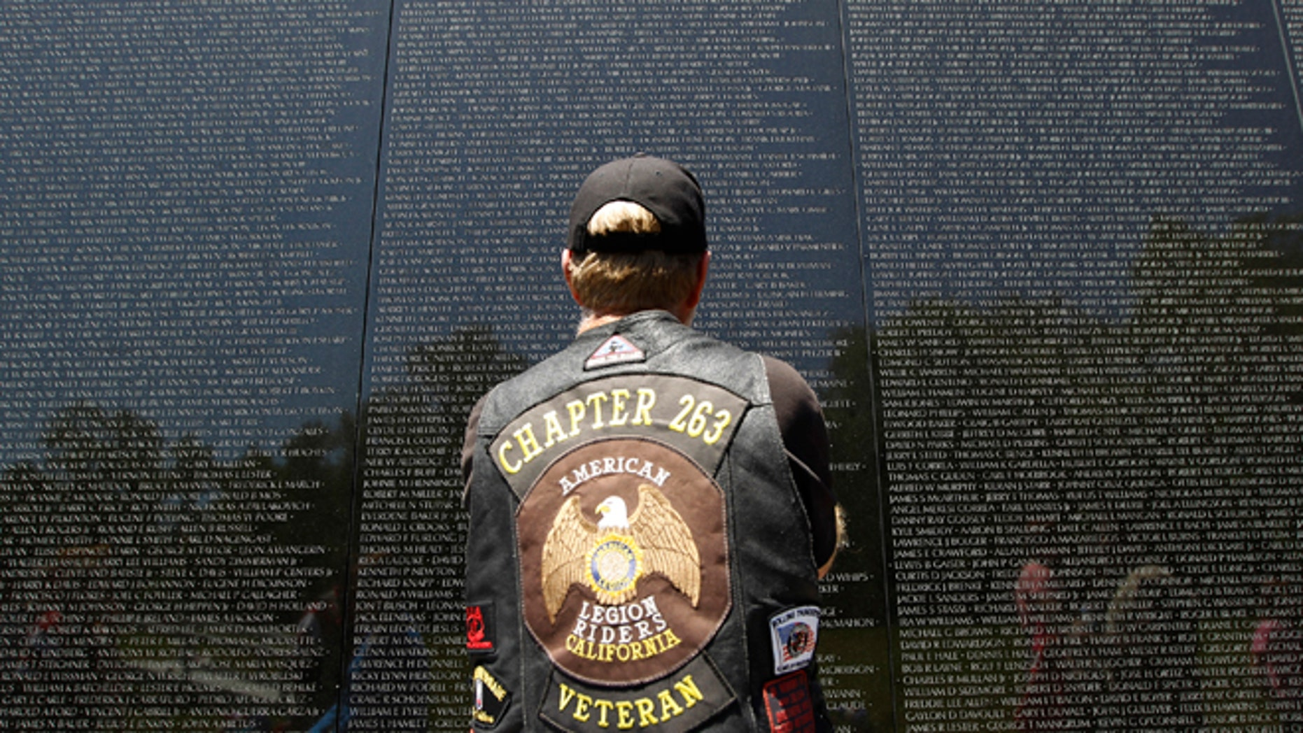 May 26, 2013: A veteran looks at the names of those who died etched into the wall of the Vietnam Veterans Memorial, ahead of Memorial Day in Washington, Sunday.
