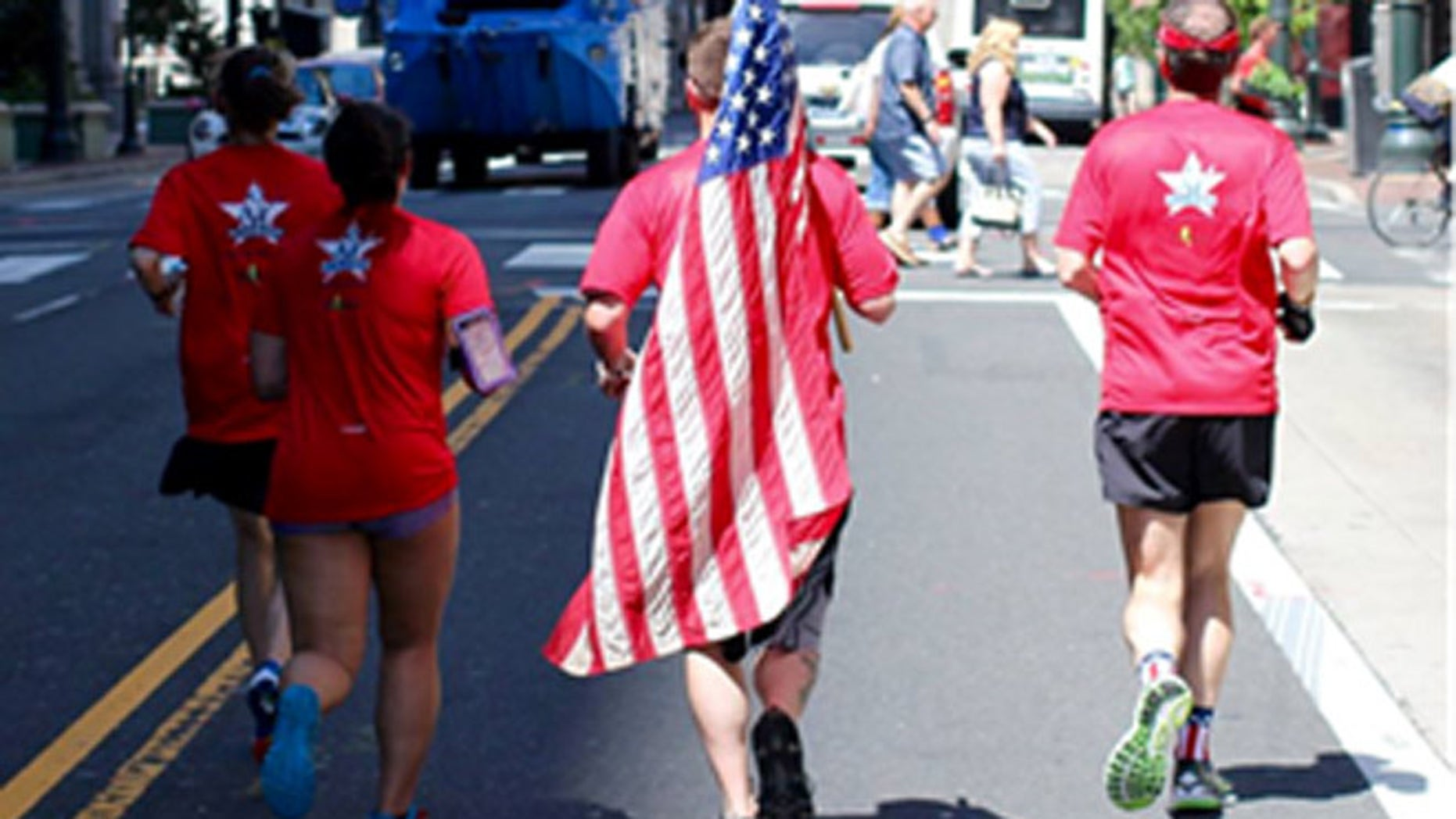 The flag on its way to the handoff on Philadelphia's historic Rocky steps.