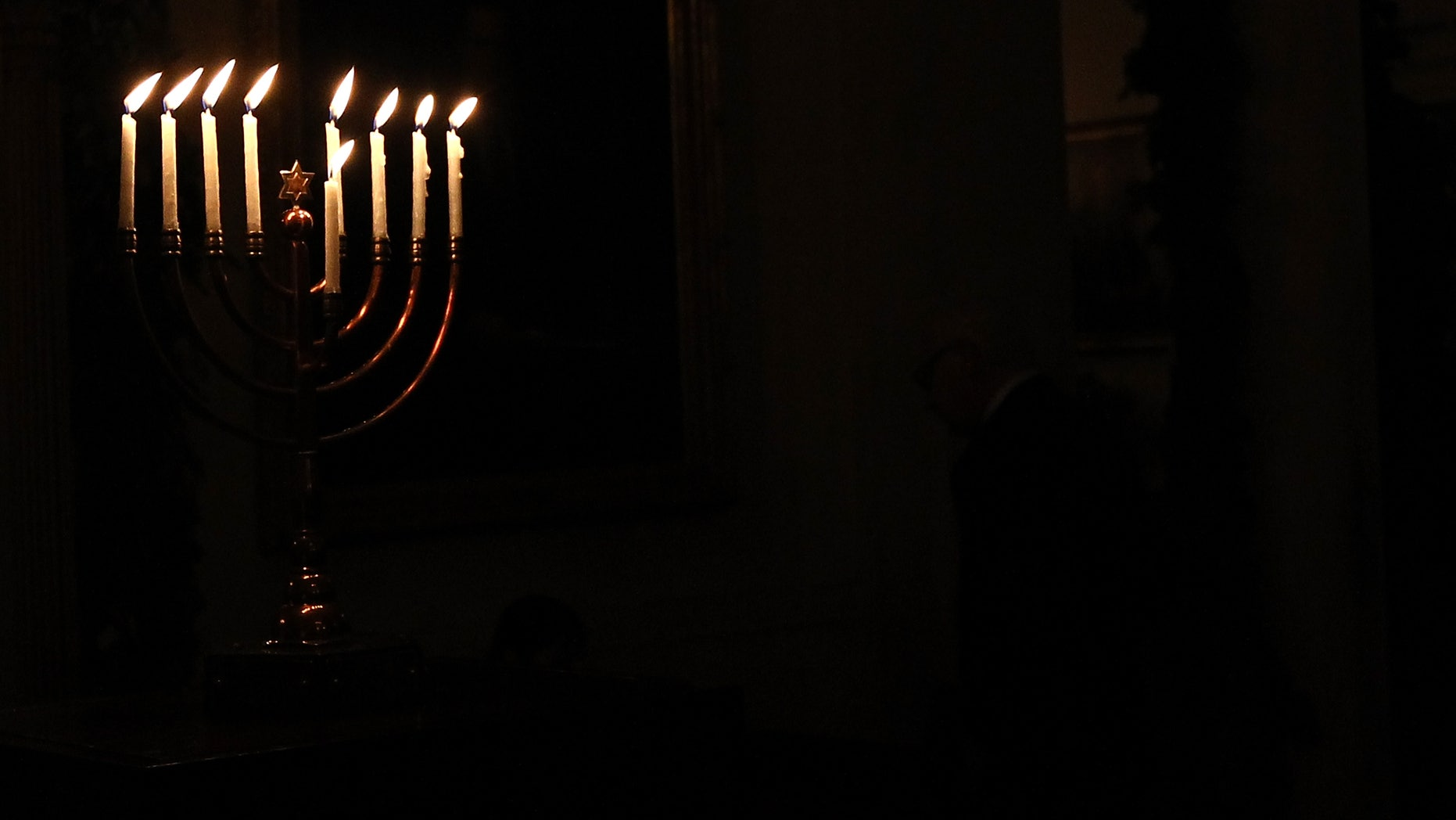 WASHINGTON, DC - DECEMBER 08:  (AFP OUT) A menorah burns in the White House after U.S. President Barack Obama delivered remarks during a Hanukkah reception December 8, 2011 in Washington, DC. The reception helped recognize and celebrate the Jewish tradition also known as the Festival of Lights.  (Photo by Win McNamee/Getty Images)