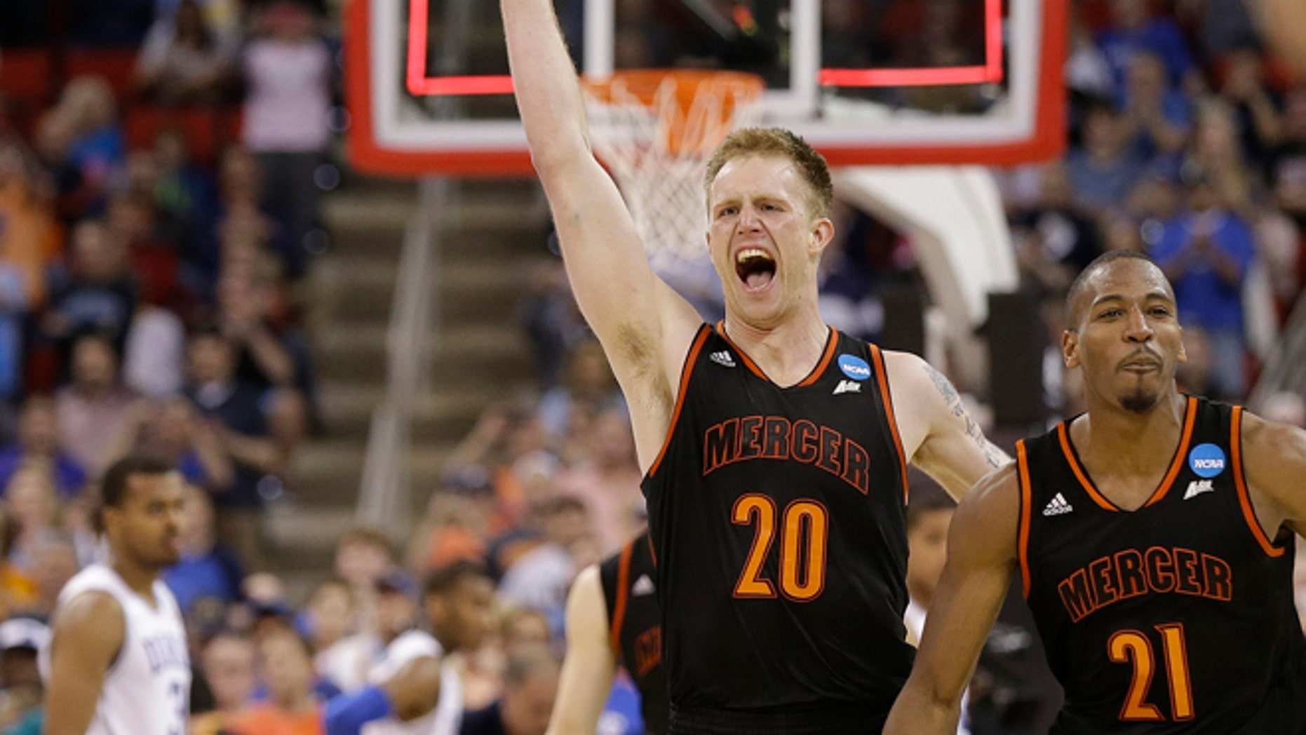 Mar. 21, 2014: Mercer forward Jakob Gollon (20) and guard Langston Hall (21) celebrate after defeating Duke 78-71 in an NCAA college basketball second-round game against Duke, in Raleigh, N.C.