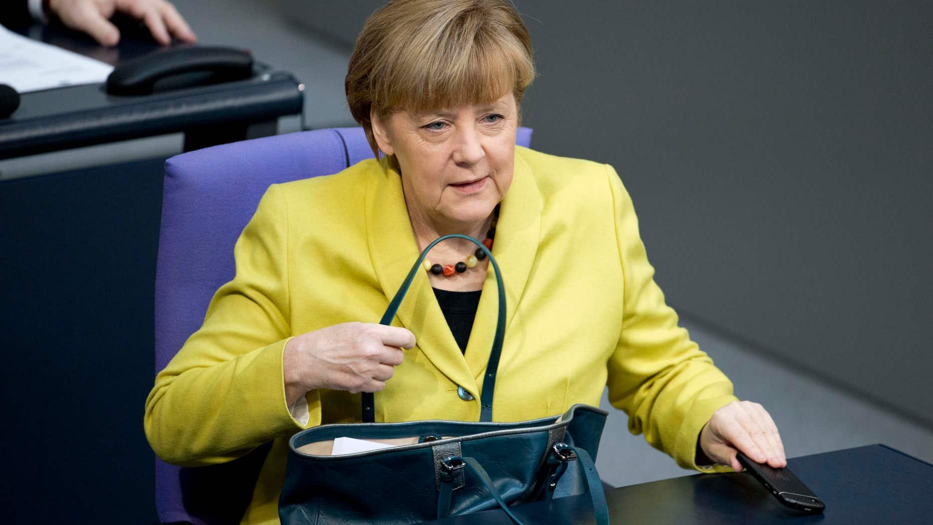 Feb. 27, 2015: German Chancellor Angela Merkel arrives for a debate at the German parliament, the Bundestag in Berlin.
