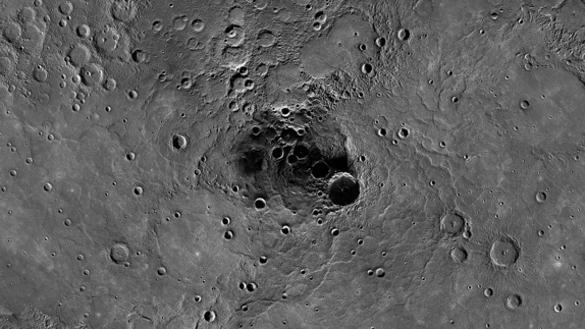 This photo mosaic of Mercury's north pole from NASA's Messenger spacecraft shows radar-bright deposits inside permanently shadowed craters on the planet. Messenger has confirmed the presence of water ice inside these regions, scientists announc