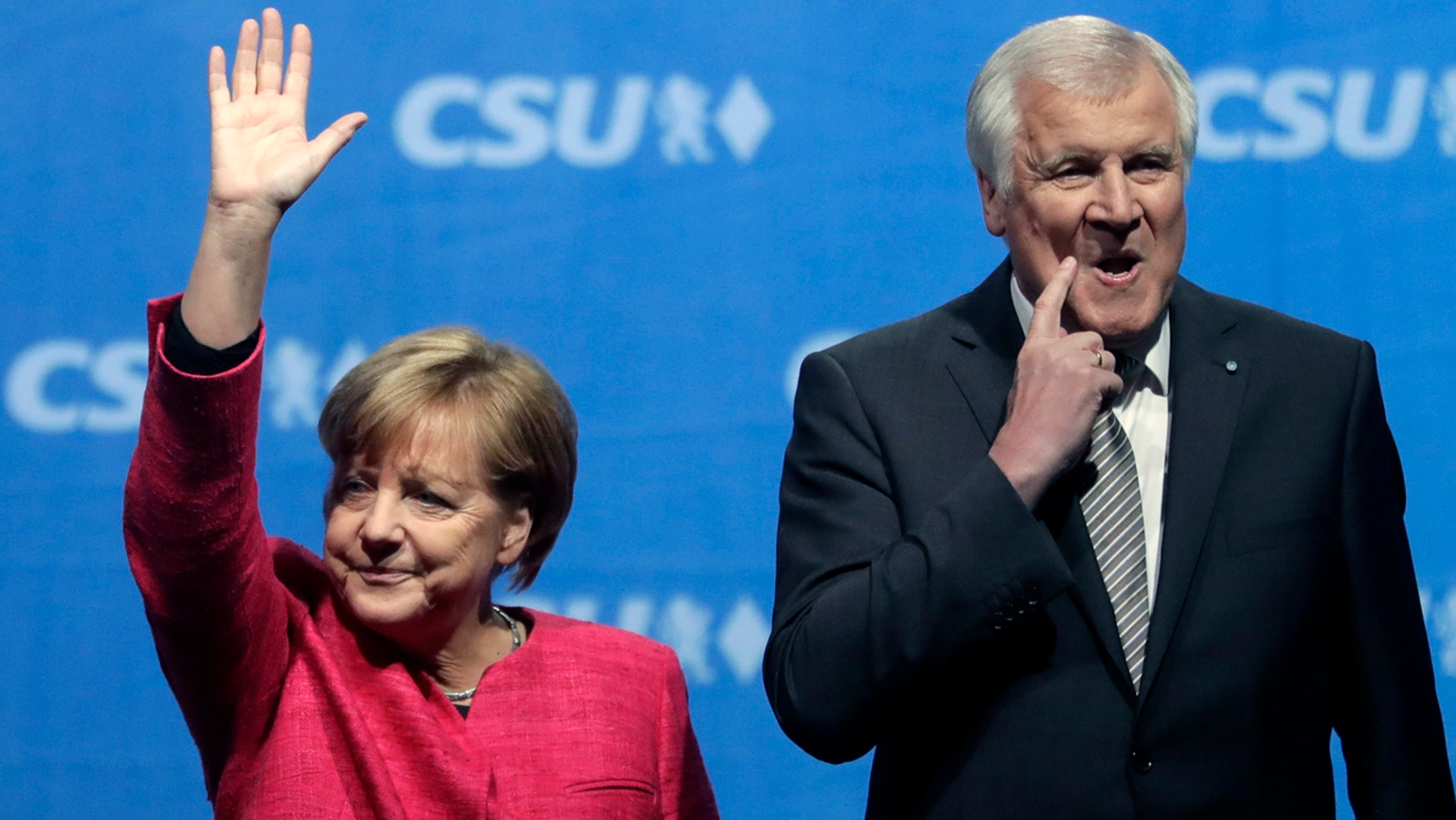 Angela Merkel and Horst Seehofer in happer times, at a September 2017 campaign rally.