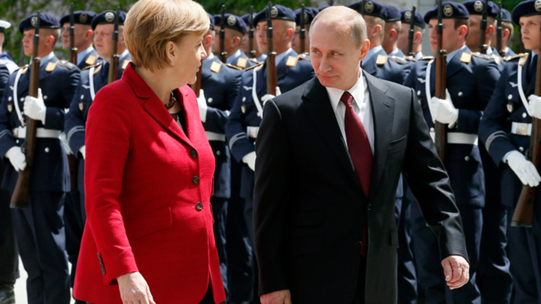 June 1, 2012: German Chancellor Angela Merkel, right, welcomes President of Russia Vladimir Putin, left, for a meeting at the chancellery in Berlin, Germany.