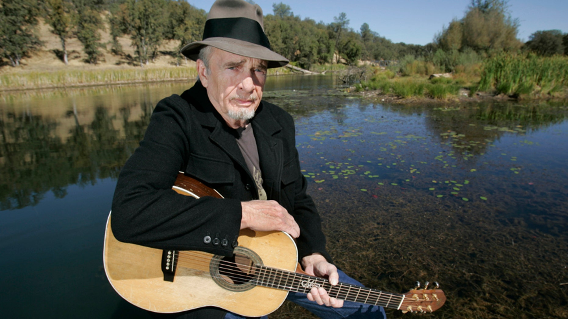 In this Oct. 2, 2007 file photo, Merle Haggard poses for a photo at his ranch at Palo Cedro, Calif. Haggard will be honored a year after his death with an all-star concert featuring his longtime friend and duet partner Willie Nelson as well as Kenny Chesney, Miranda Lambert and John Mellencamp. The country music star died of pneumonia on April 6, 2016, in Palo Cedro. He was 79.