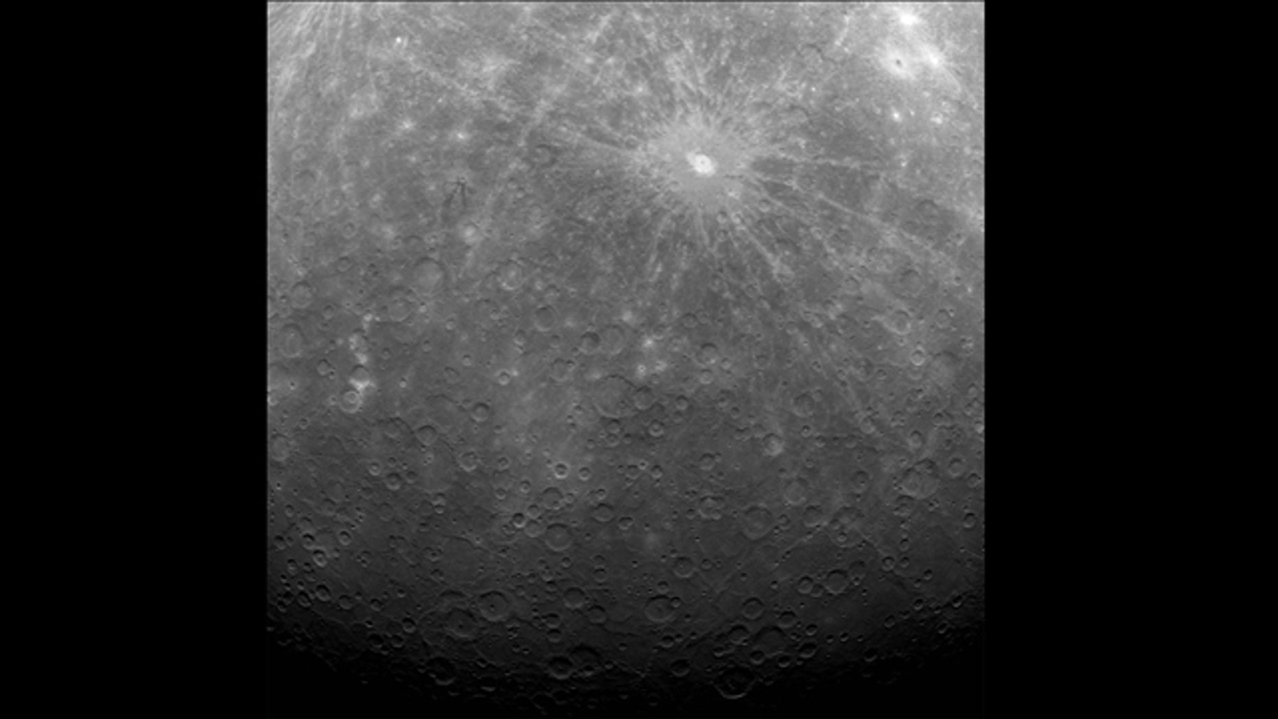 NASA's Mercury Messenger probe captured this historic image of Mercury, the first ever obtained from a spacecraft in orbit about the solar system's innermost planet. The photo was taken on Tuesday (March 29) at 5:20 am EDT.