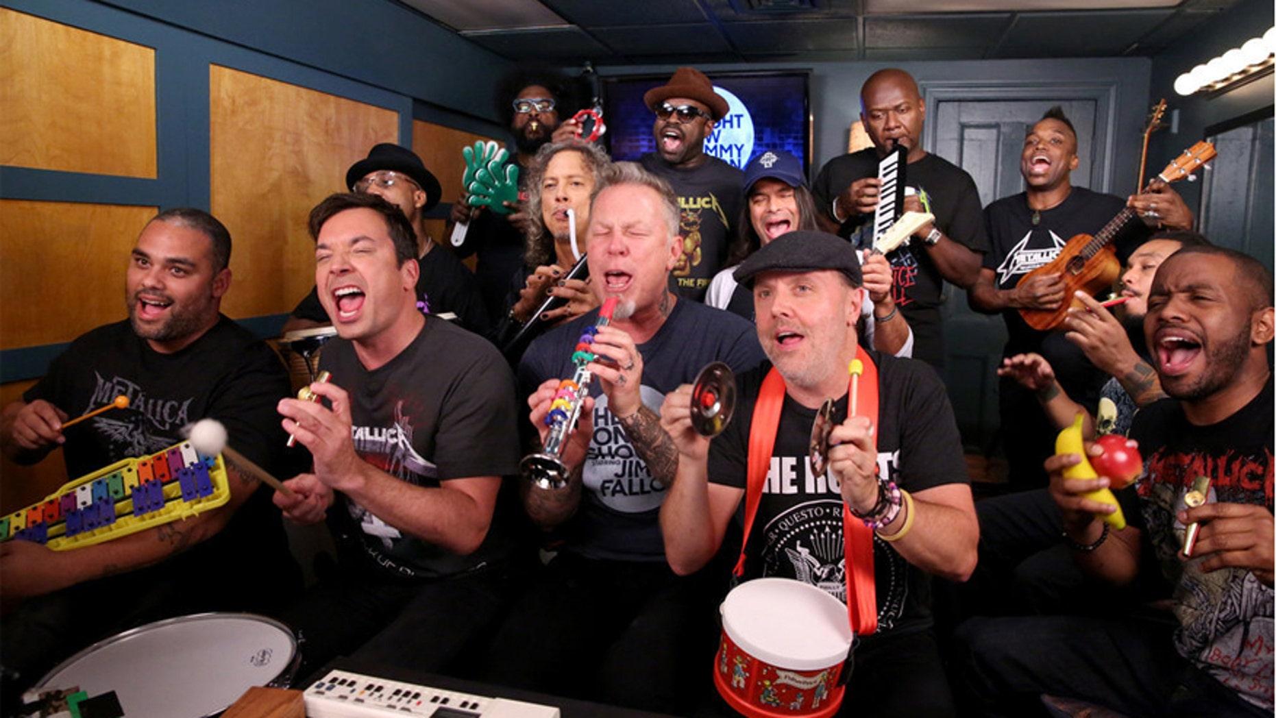 "Pictured: (l-r) James ""Kamal"" Gray, host Jimmy Fallon, Frank ""Knuckles"" Walker, Ahmir ""Questlove"" Thompson, Kirk Hammett, James Hetfield, Tariq ""Black Thought"" Trotter, Robert Trujillo, Lars Ulrich, James Poyser, Kirk ""Captain Kirk"" Douglas, Mark Kelley, and Damon ""Tuba Gooding Jr."" Bryson sing during the ""Metallica Music Room"" sketch on November 16, 2016."