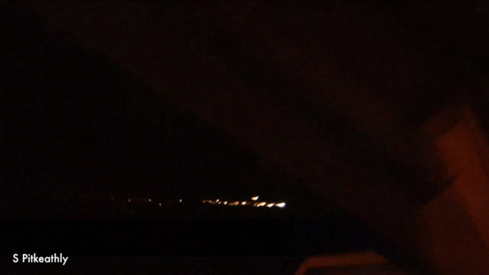 Night sky watcher Stuart Pitkeathly posted a video online reportedly showing a meteor breaking up over Dalbeattie, Scotland, in this southwestern part of the country. Video posted on YouTube September 21, 2012.