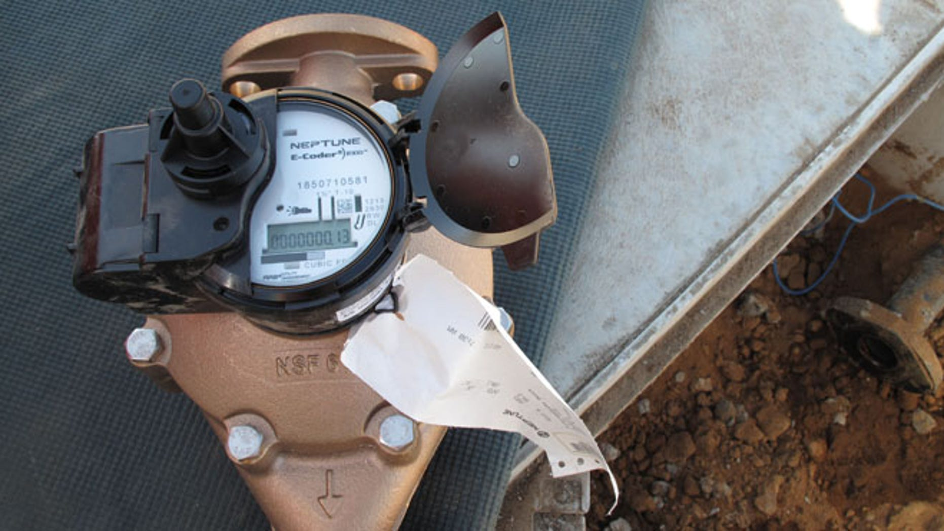 Sept. 4, 2014: In this photo a water meter being installed at the site of a new home under construction in Fresno, Calif.